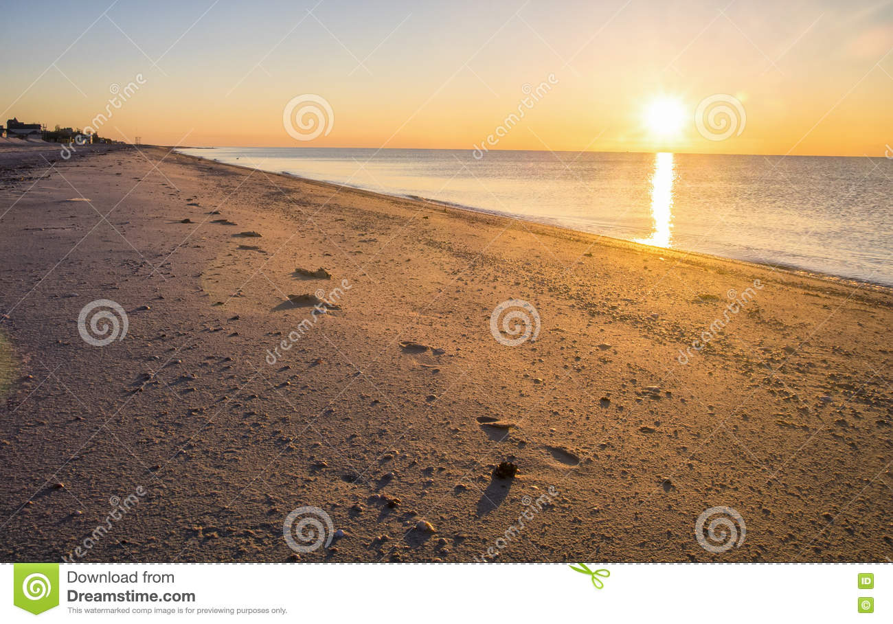 Footprints In The Sand, Sunset At The Seaside Stock Photo ...