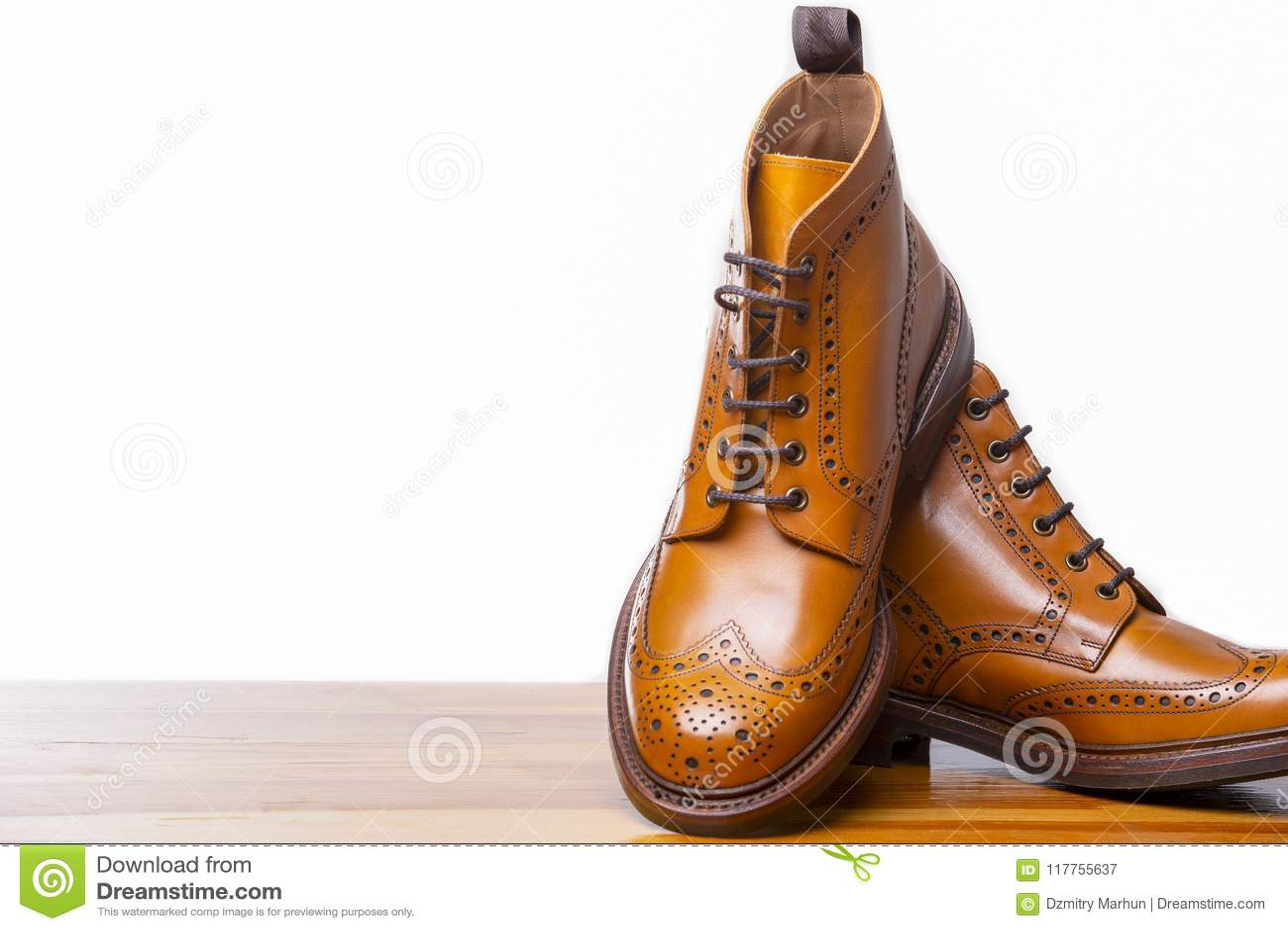 Footwear Concepts.Closeup of Pair of High Gentleman Tanned Brogues