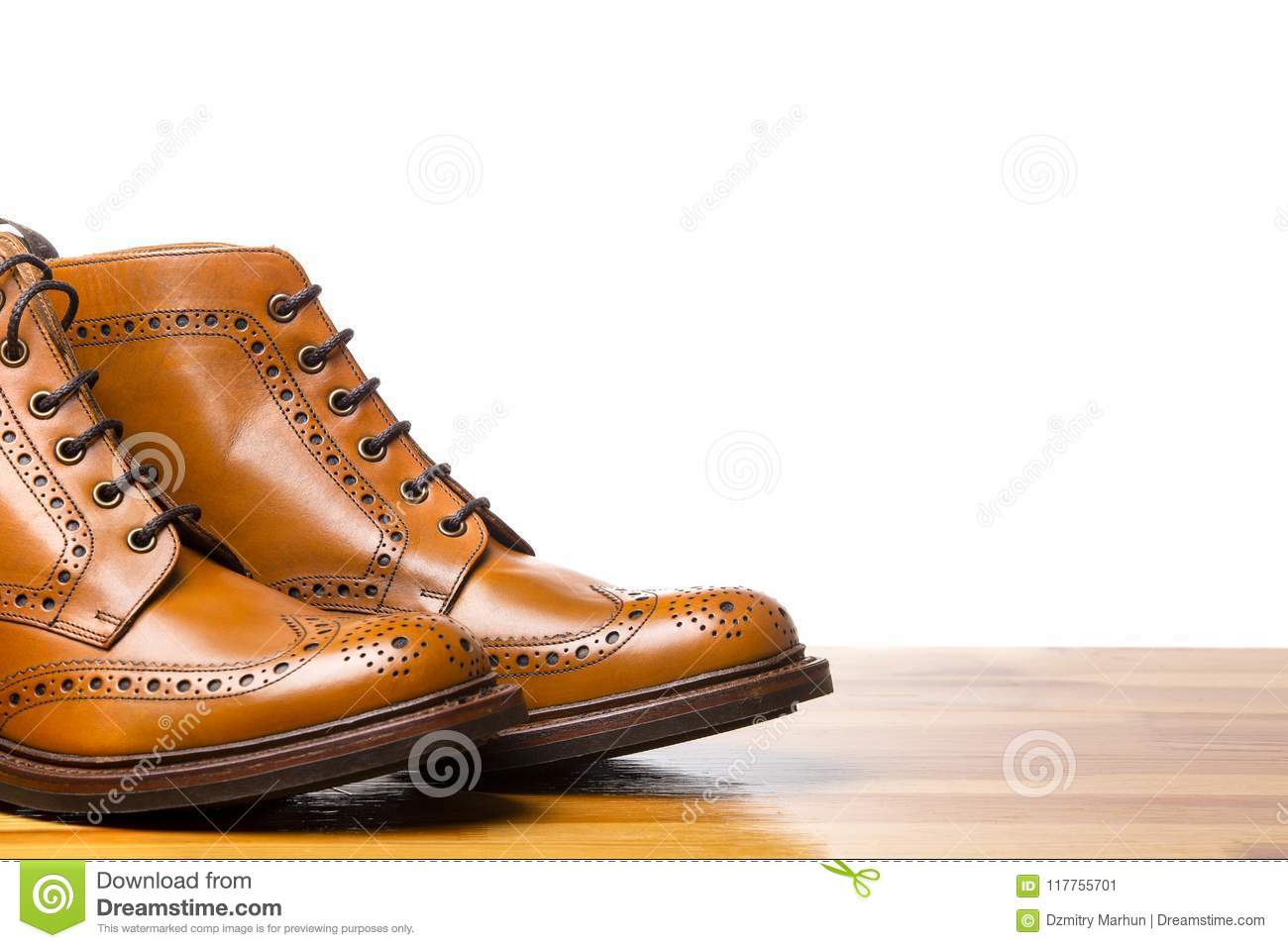 Footwear Concepts.Closeup of Tips of Pair of Tanned Brogues Boots