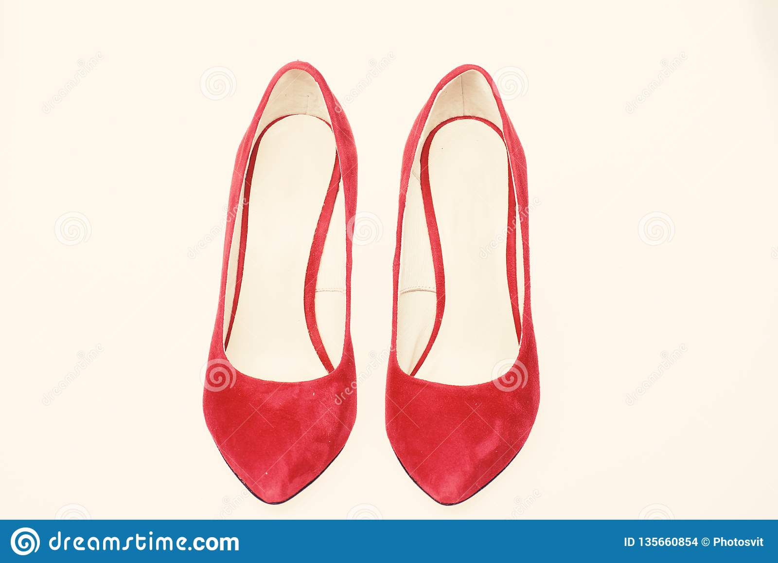 568d86bfa Pair of fashionable high heeled pump shoes.Elegant stiletto shoes concept.  Shoes made out of red suede on white background, isolated.