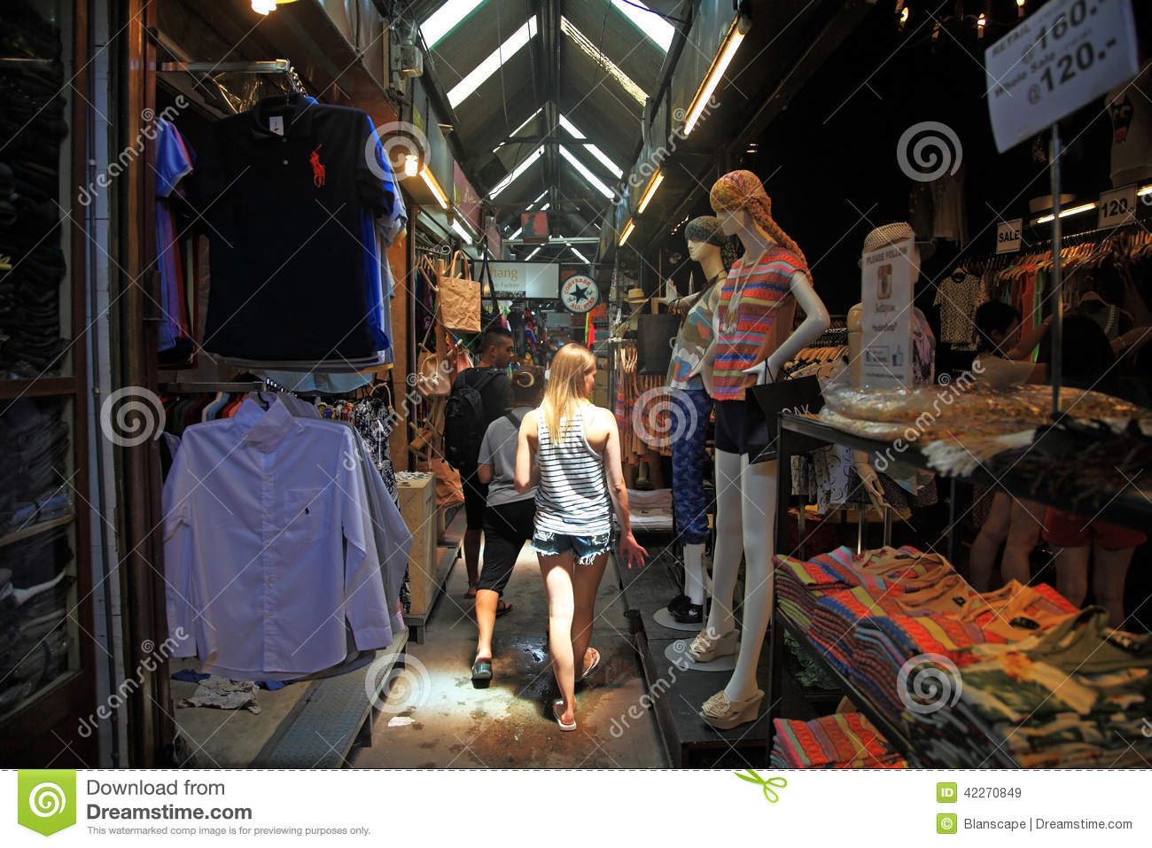 7d7fcd063ab BANGKOK, THAILAND - JULY 05, 2014: Unidentified foreign girl shopping at  Chatuchak weekend market. Here is the largest weekend market opened from  8am - 6pm ...