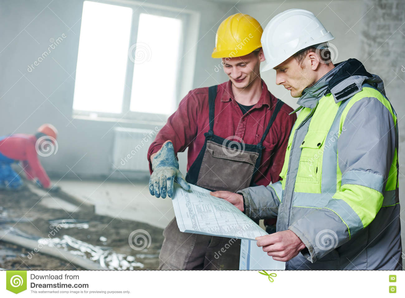 Foreman builder and construction worker with blueprint in for Builder floor