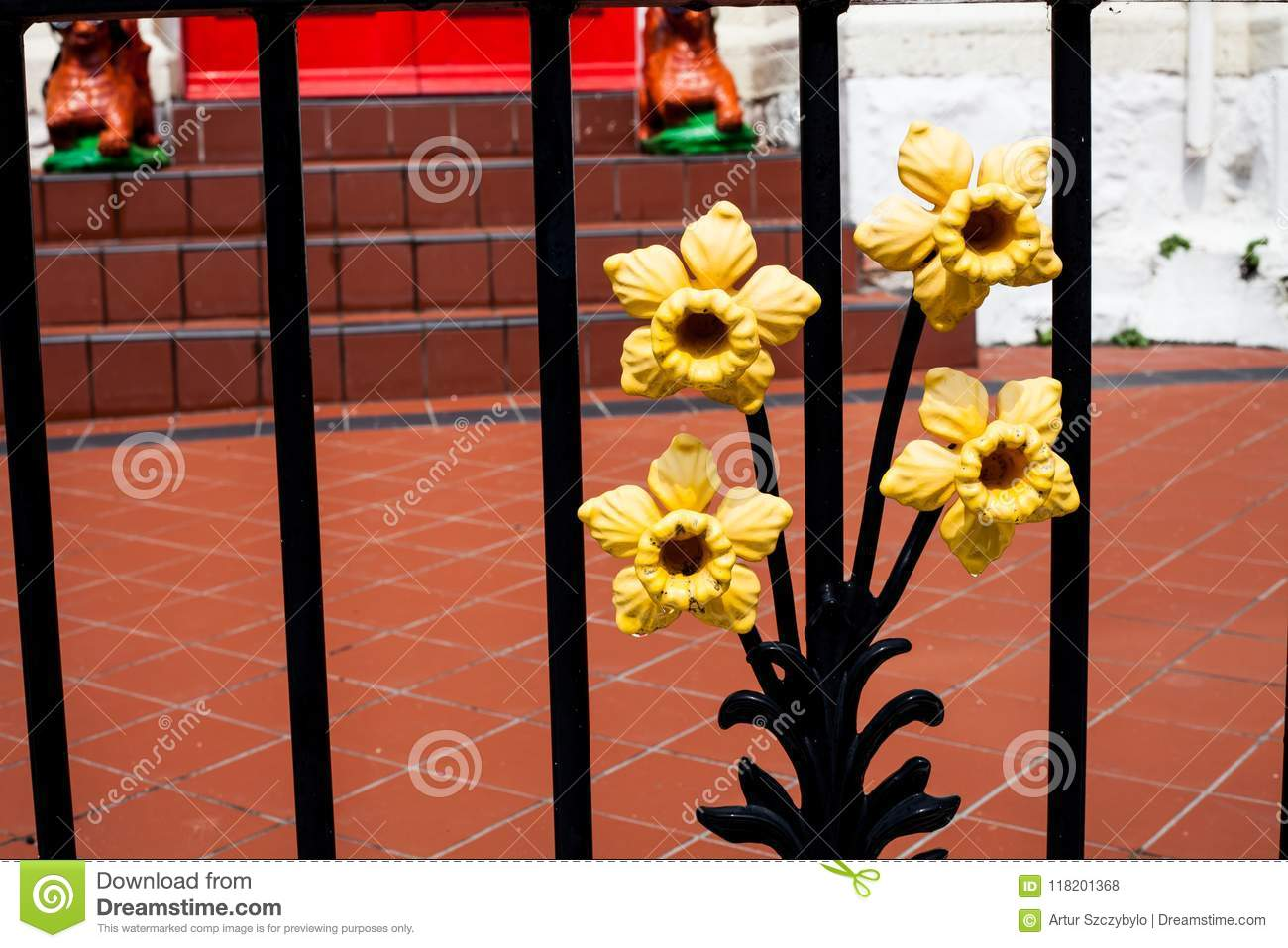 Forged Yellow Items On Gate  Decorative Fragment In The Form Of A