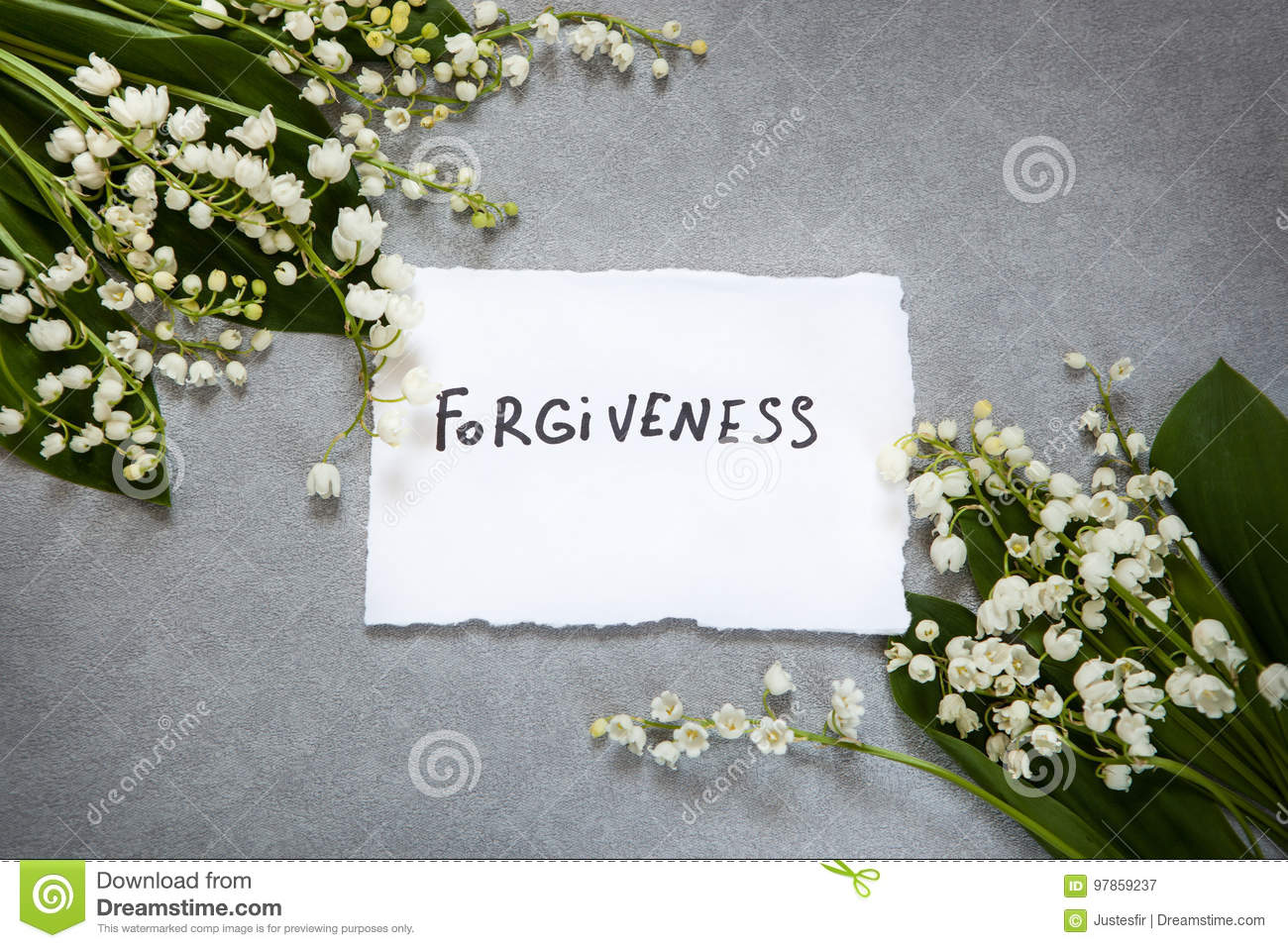 Forgiveness word with white flowers