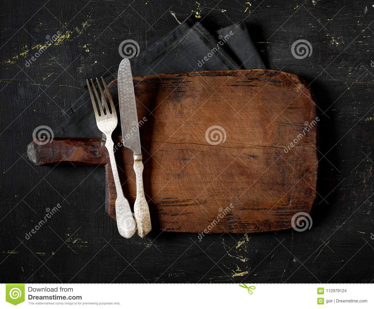 Fork, knife and cutting board
