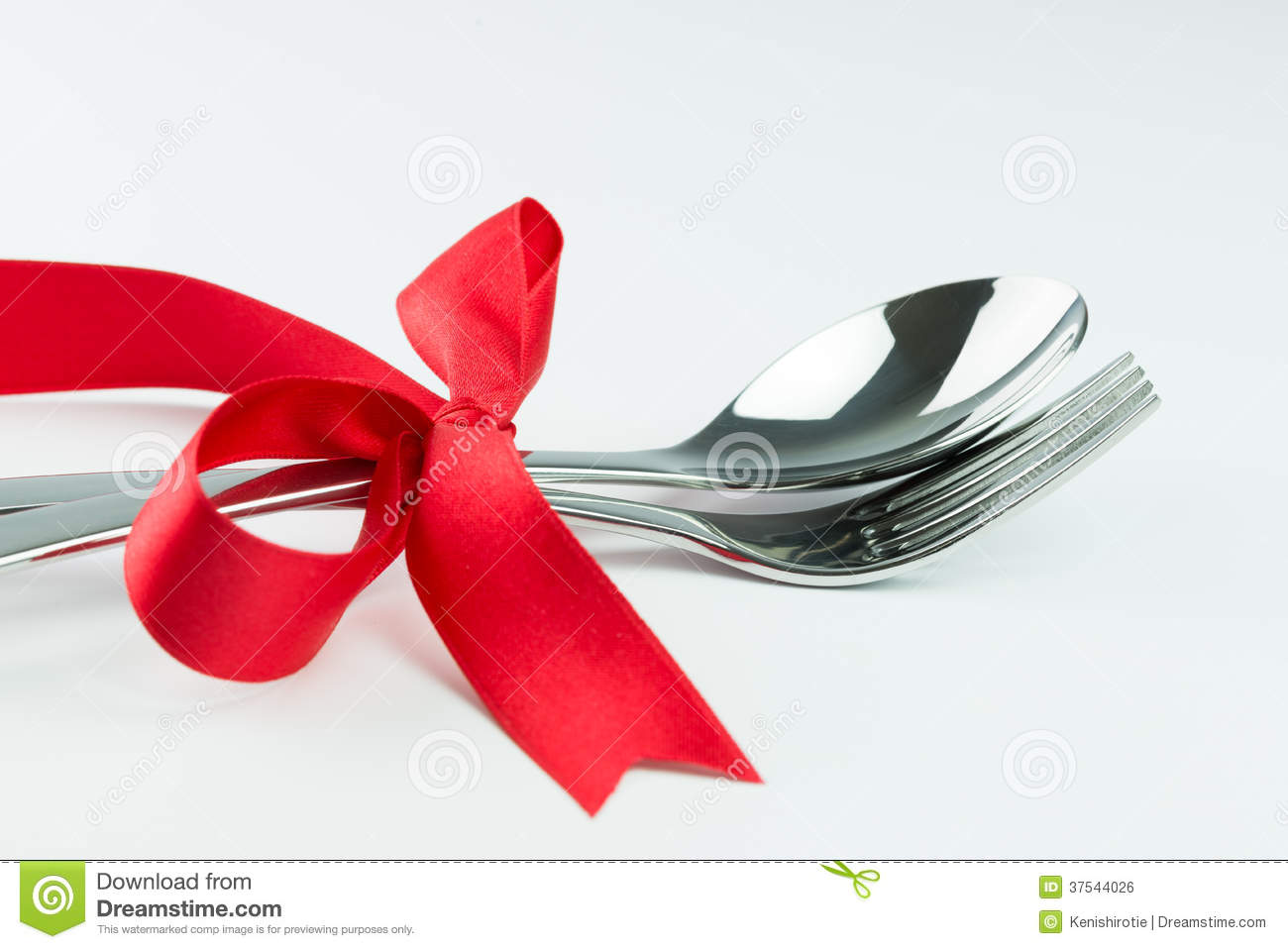 Fork Knife And Spoon Tied Up With Red Ribbon Royalty Free