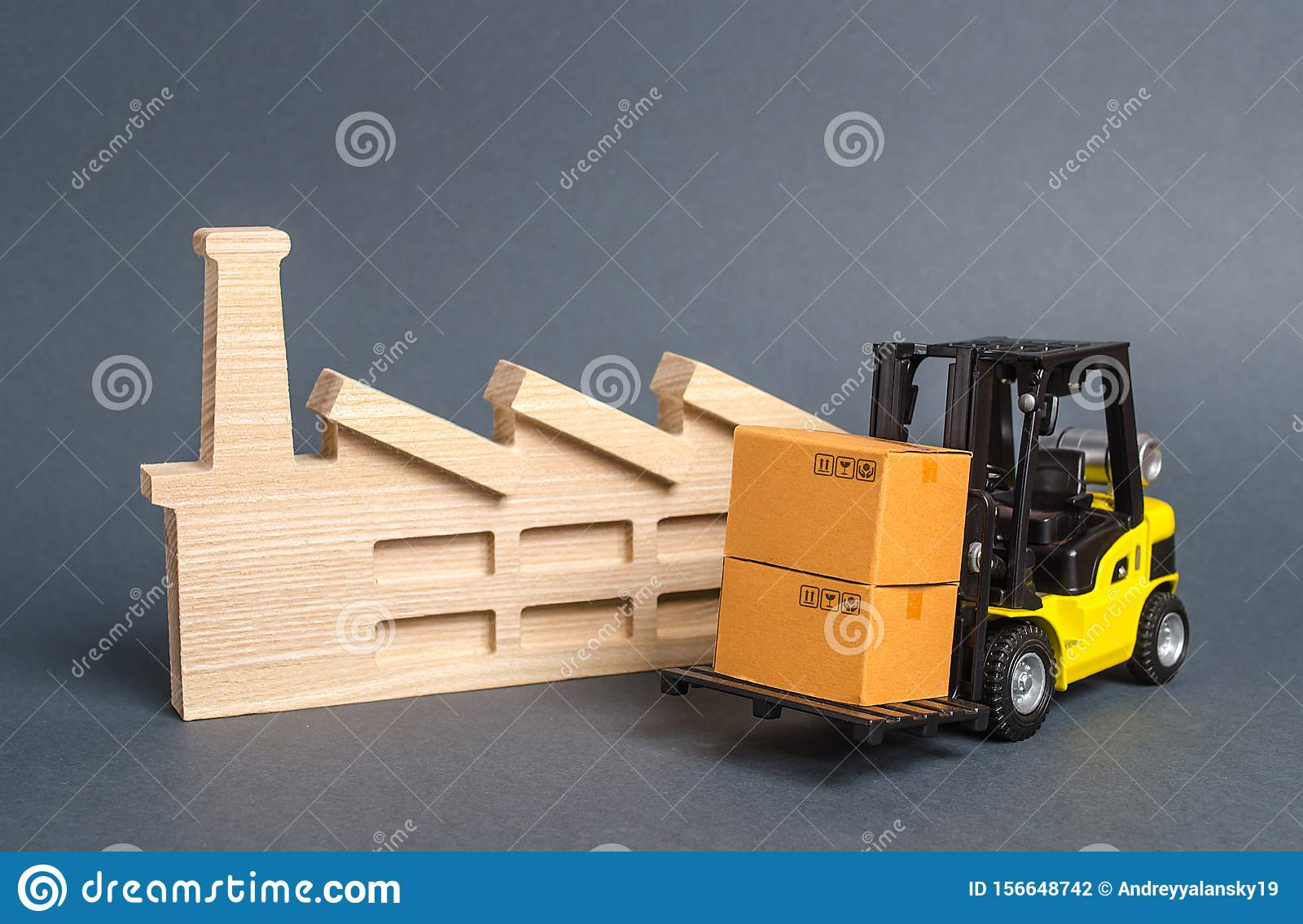 Forklift carries cardboard boxes and building a factory or plant. Services transportation of goods products, logistics