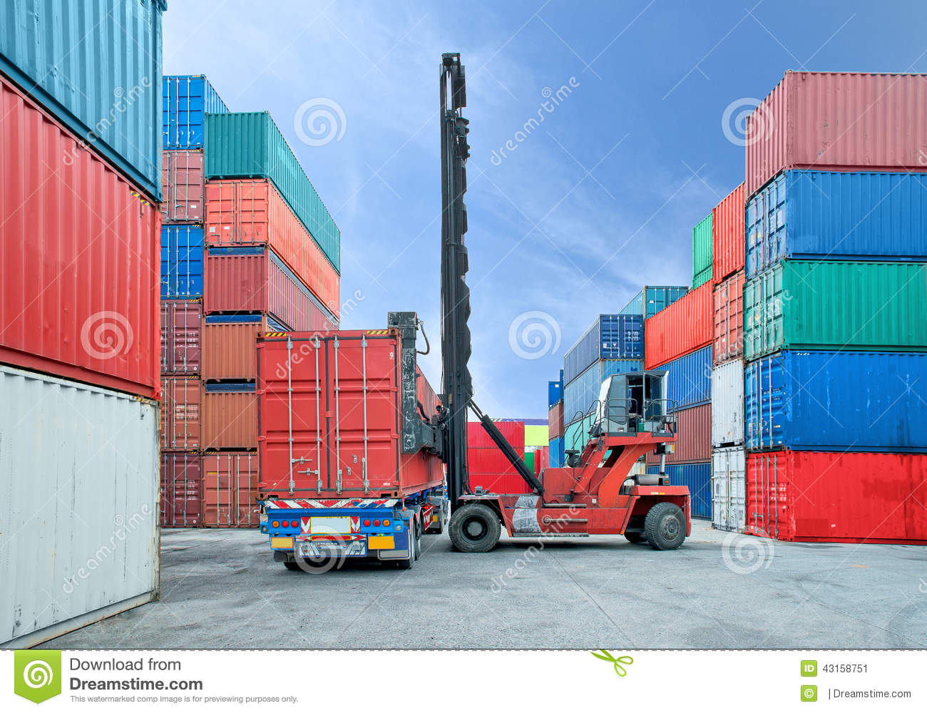 Forklift handling container box loading to truck in dock