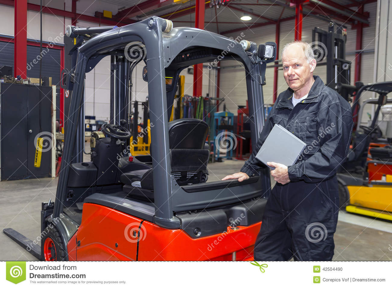 Forklift Mechanic With Manual Stock Photo Image - Forklift mechanic