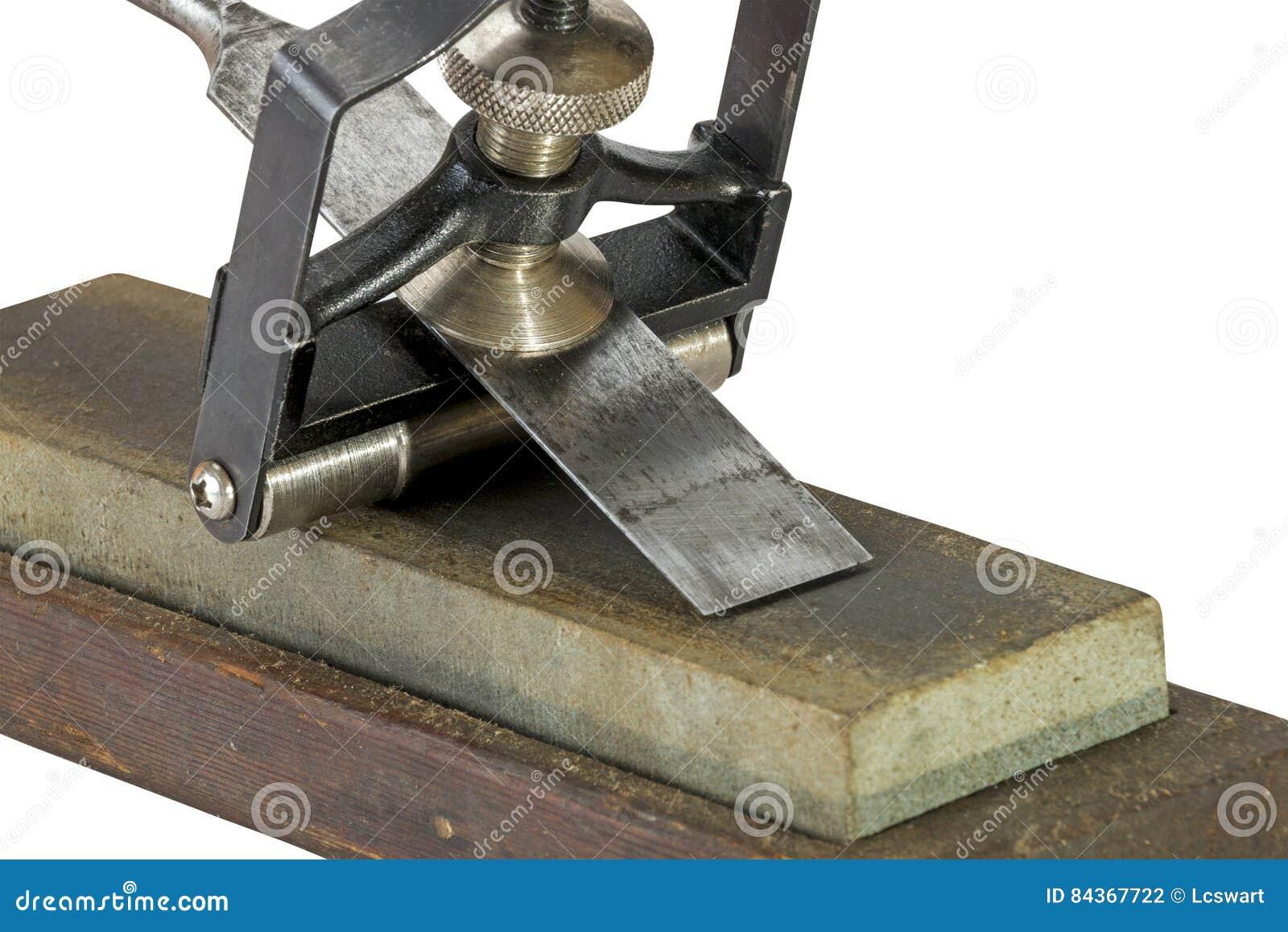 Formão apertado em gabaritos do guia do ângulo em mós de moedura