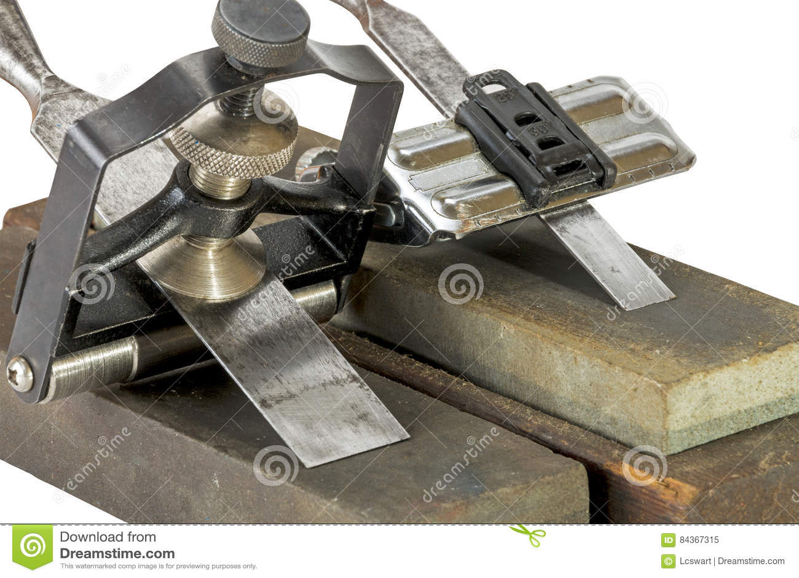 Formões apertados em gabaritos do guia do ângulo em mós de moedura