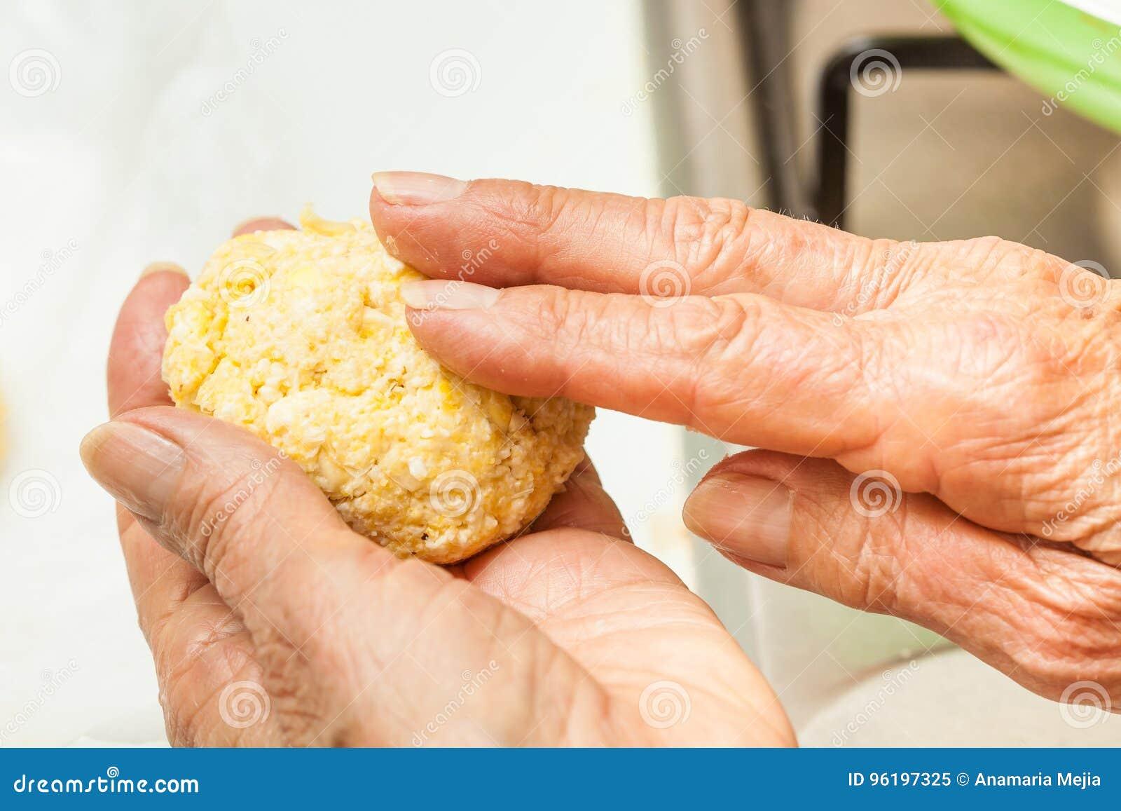 Form corn dough into medium sized balls