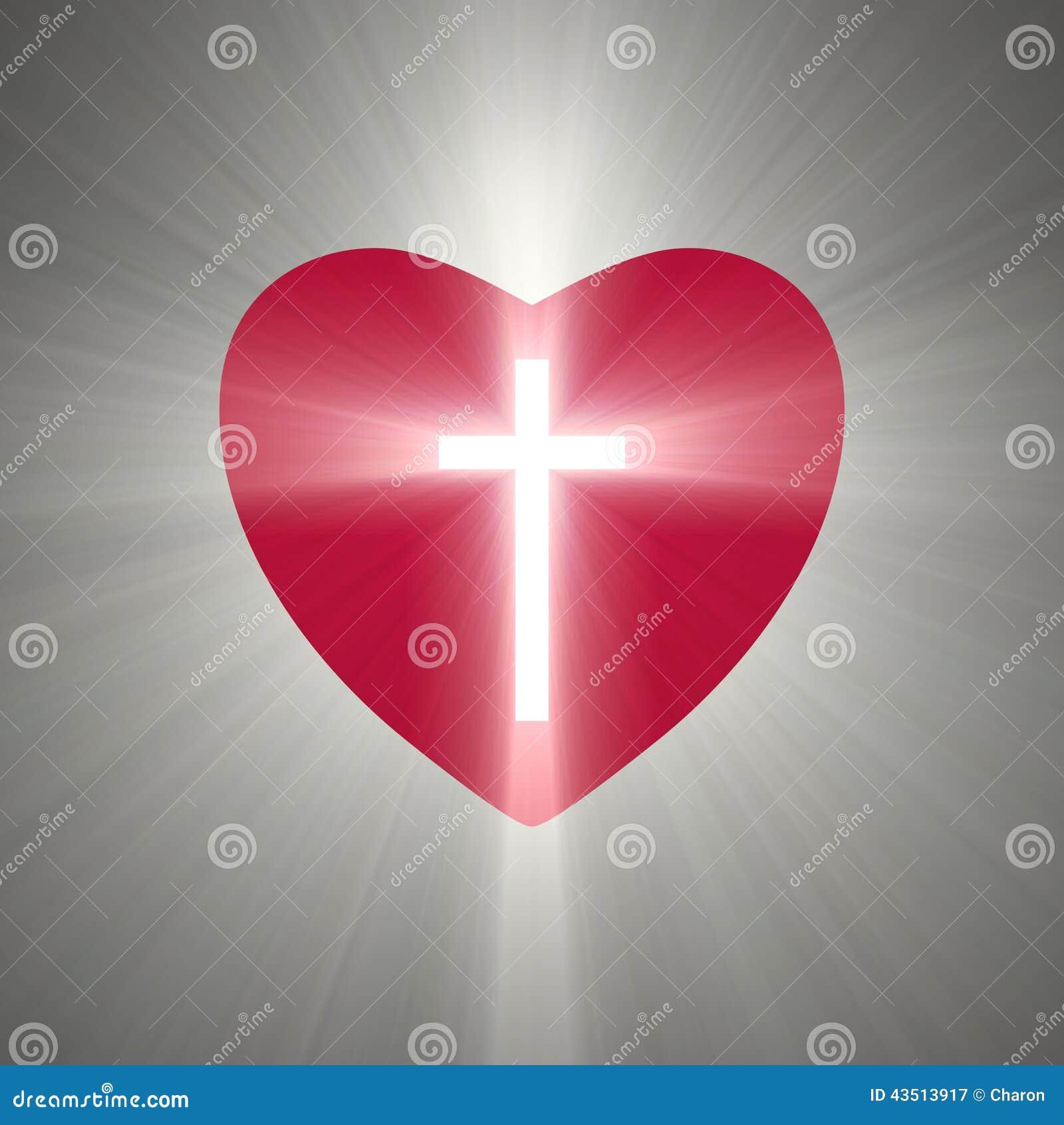 Forma do coração com uma cruz de brilho para dentro