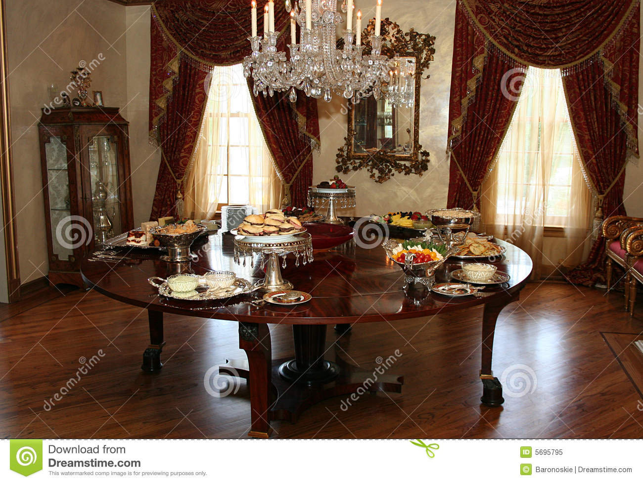 Formal dining room with china cabinet and chandelier stock for Formal dining room chandelier