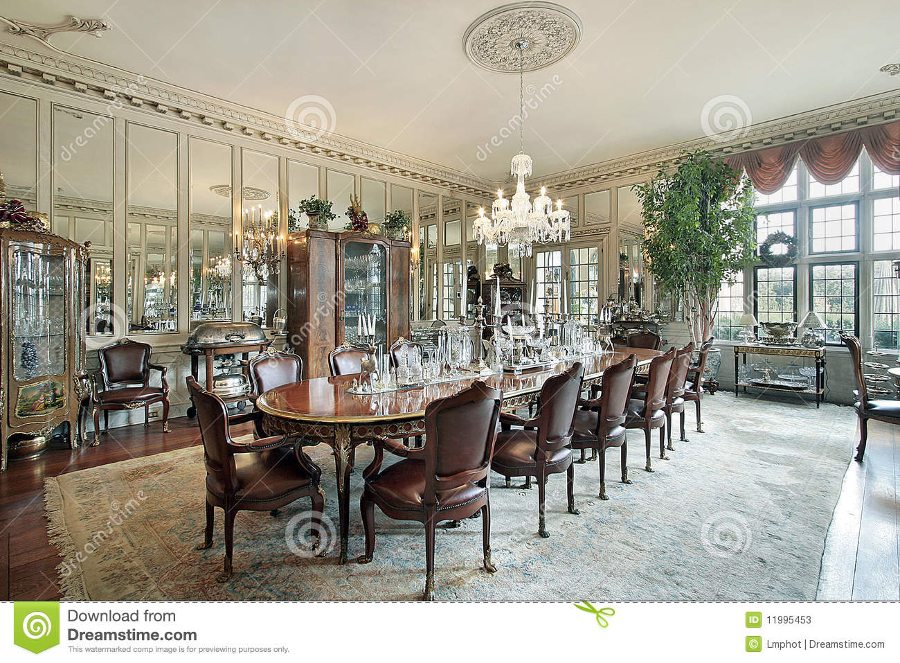 formal dining room with wall mirrors stock photos - image: 11995453