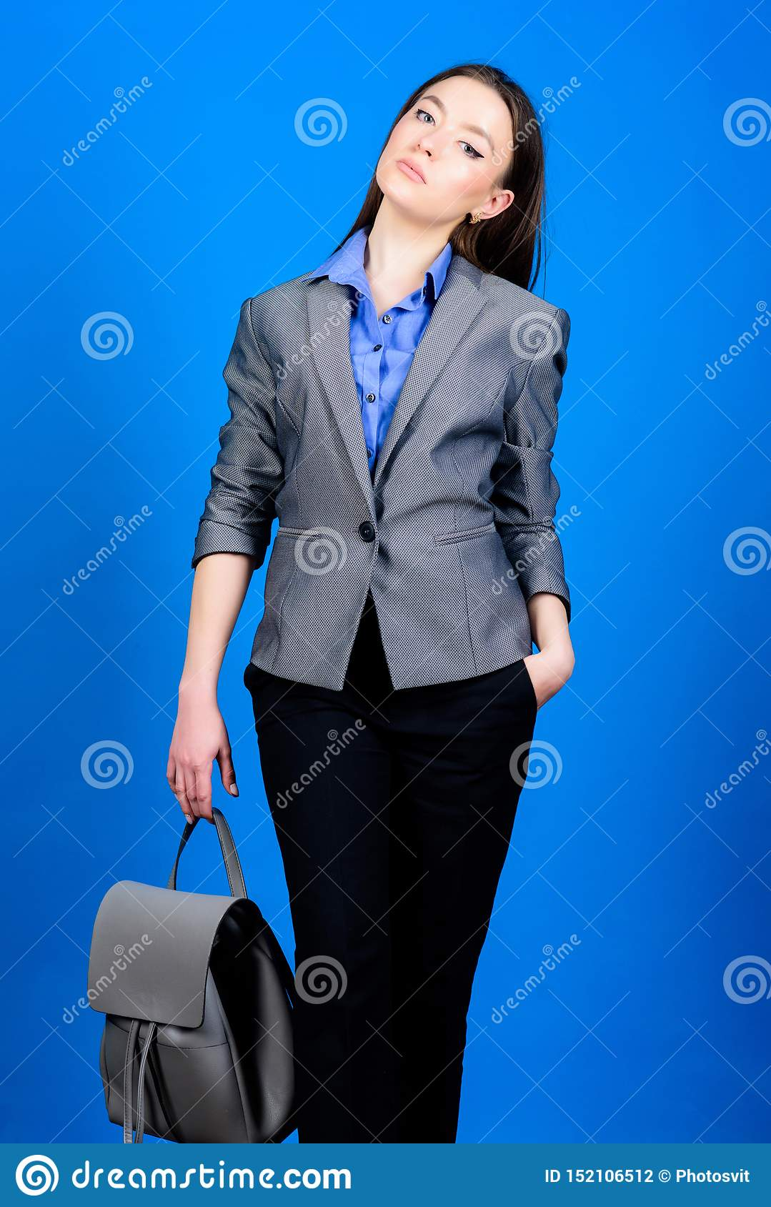 Formal style accessories. Backpack for daily modern urban life. Girl student in formal clothes. Backpack fashion trend