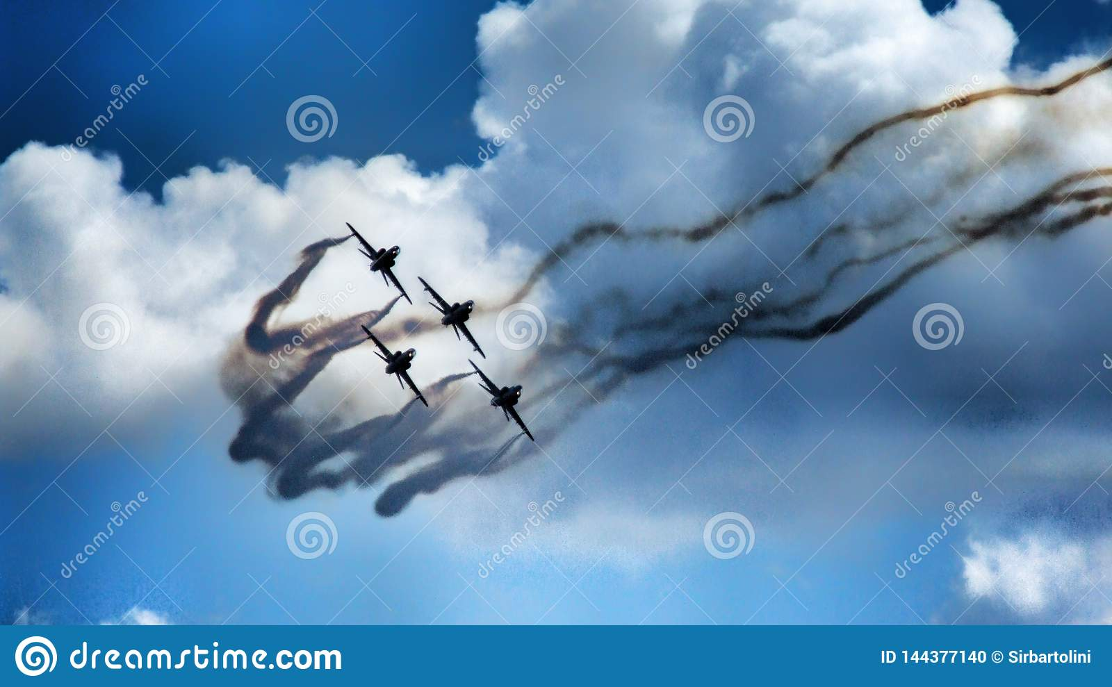 Formation of four jet aircraft in aerobatic team.