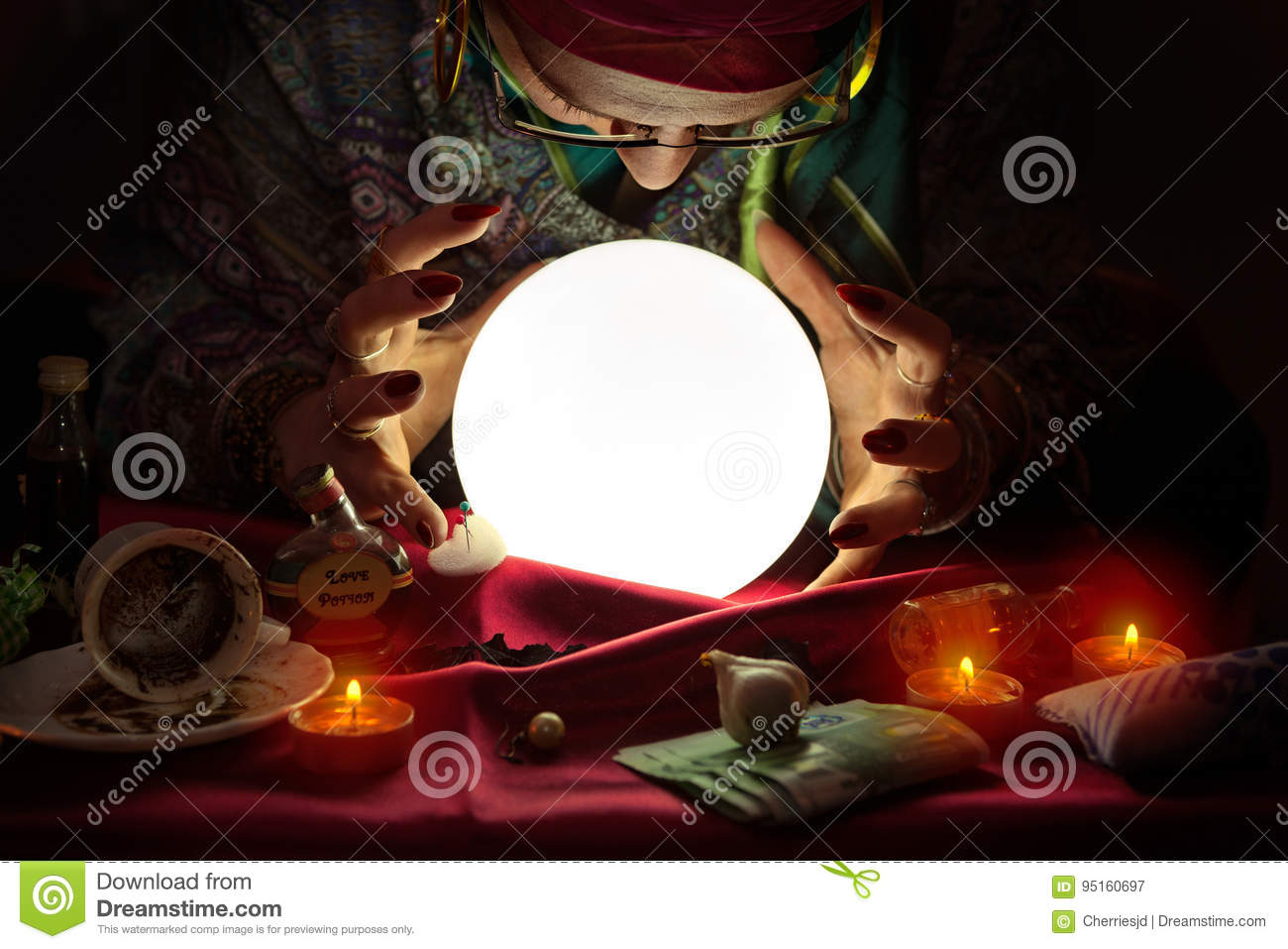 Fortune Teller Woman Staring At Crystal Ball Stock Image