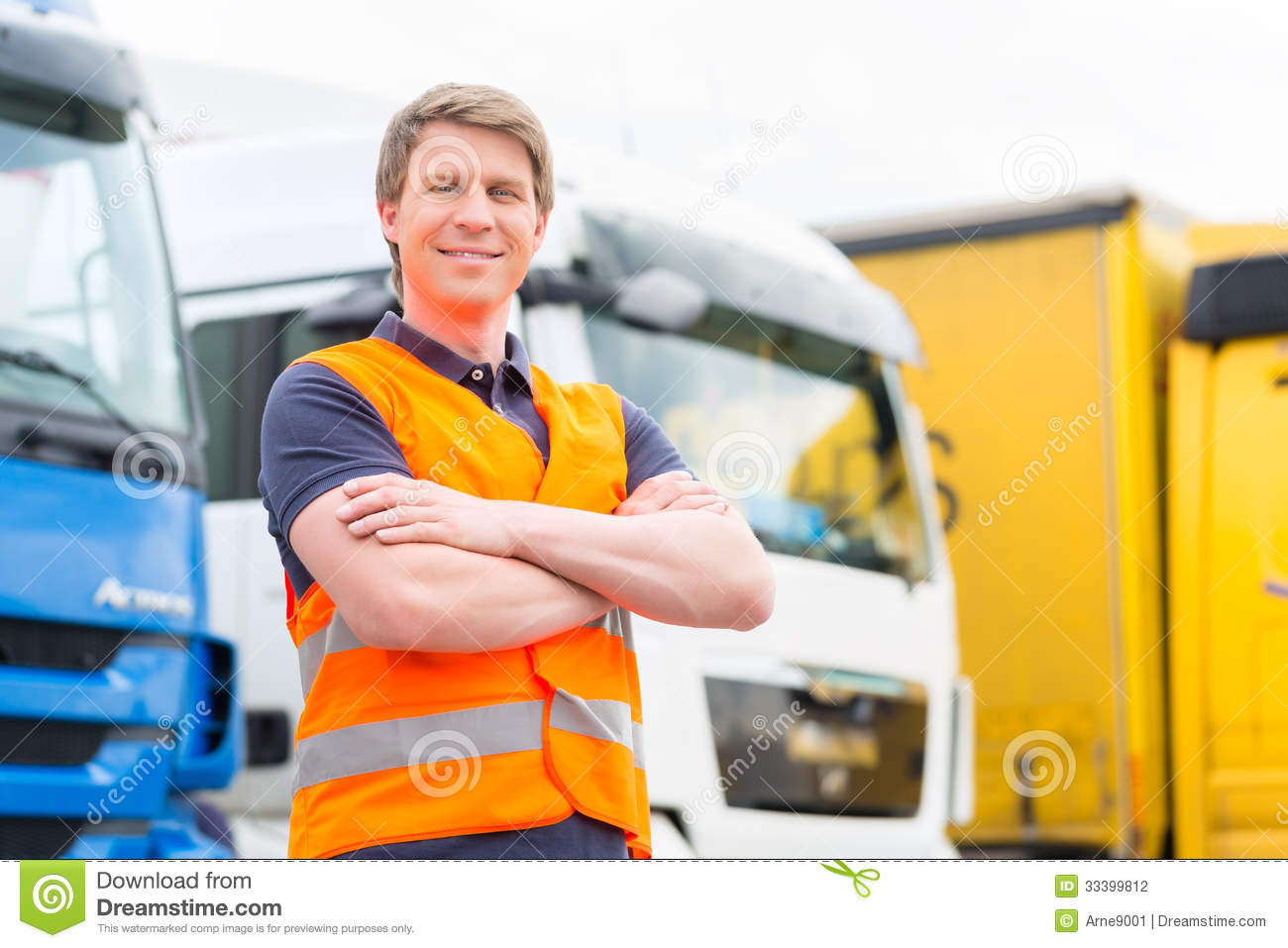 Forwarder or driver in front of trucks in depot
