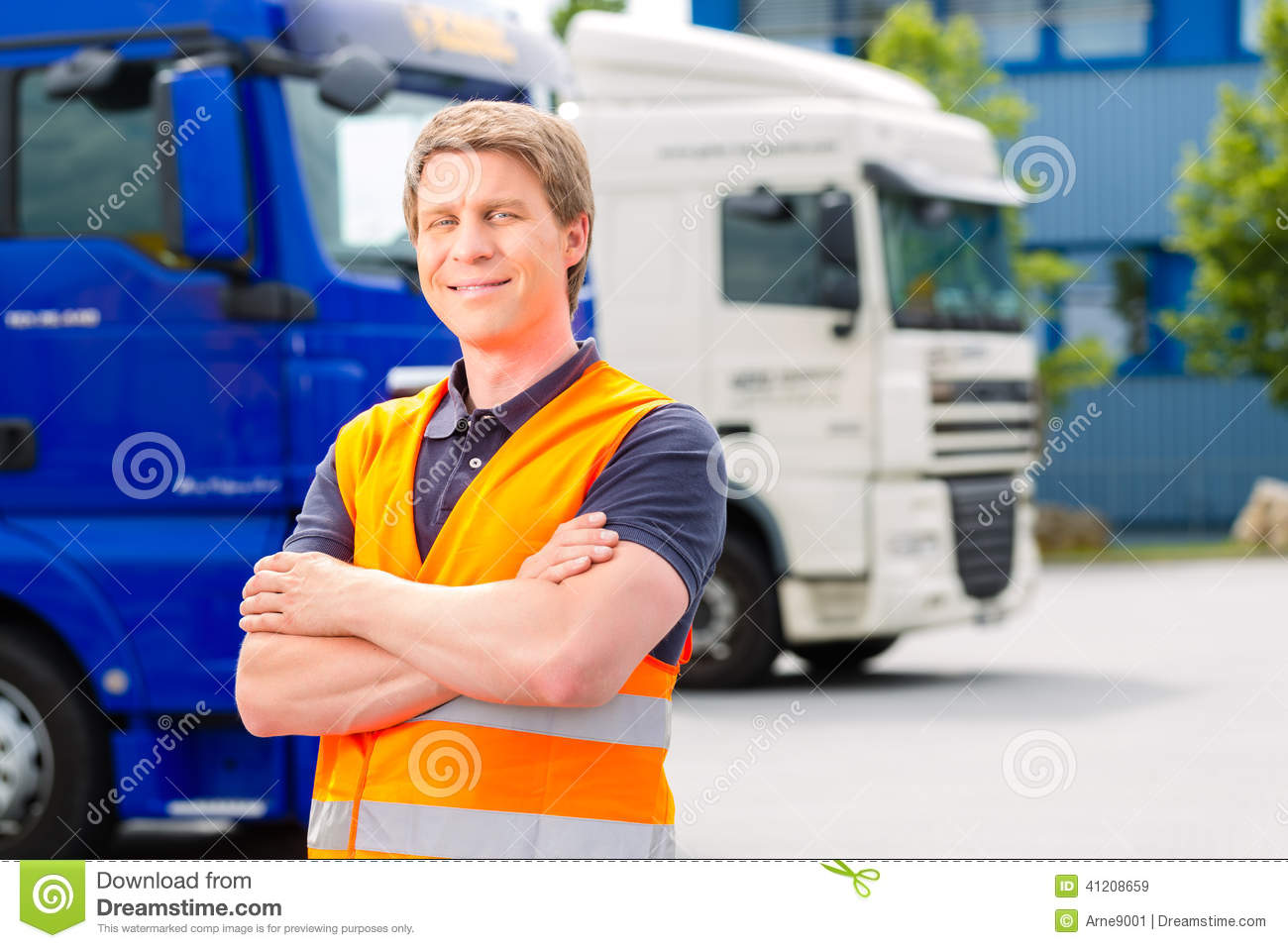 Forwarder in front of trucks on a depot