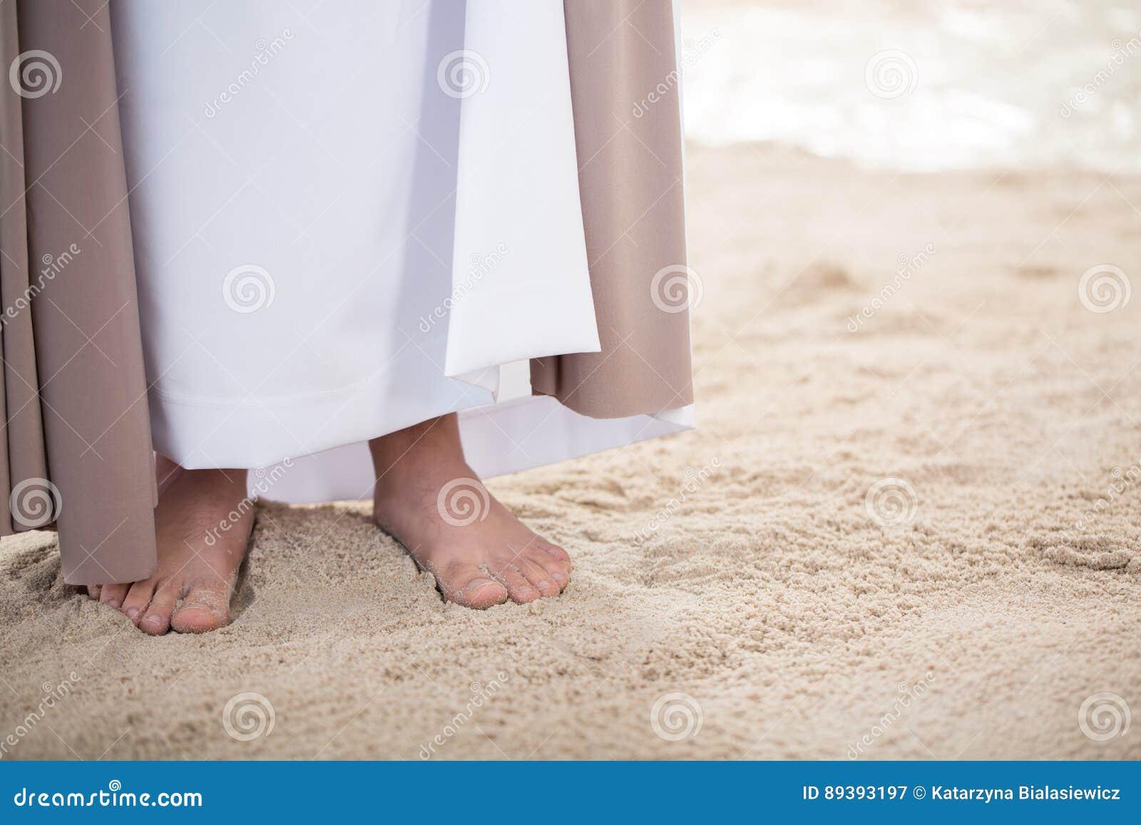 Fot av Jesus på sand