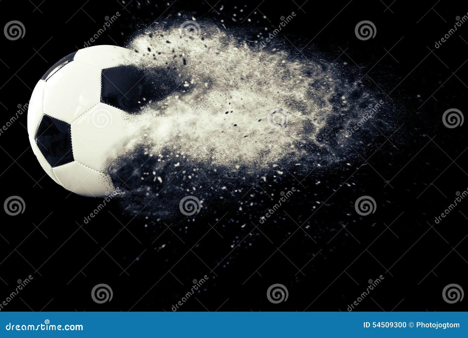 Fotbollboll med partiklar och damm