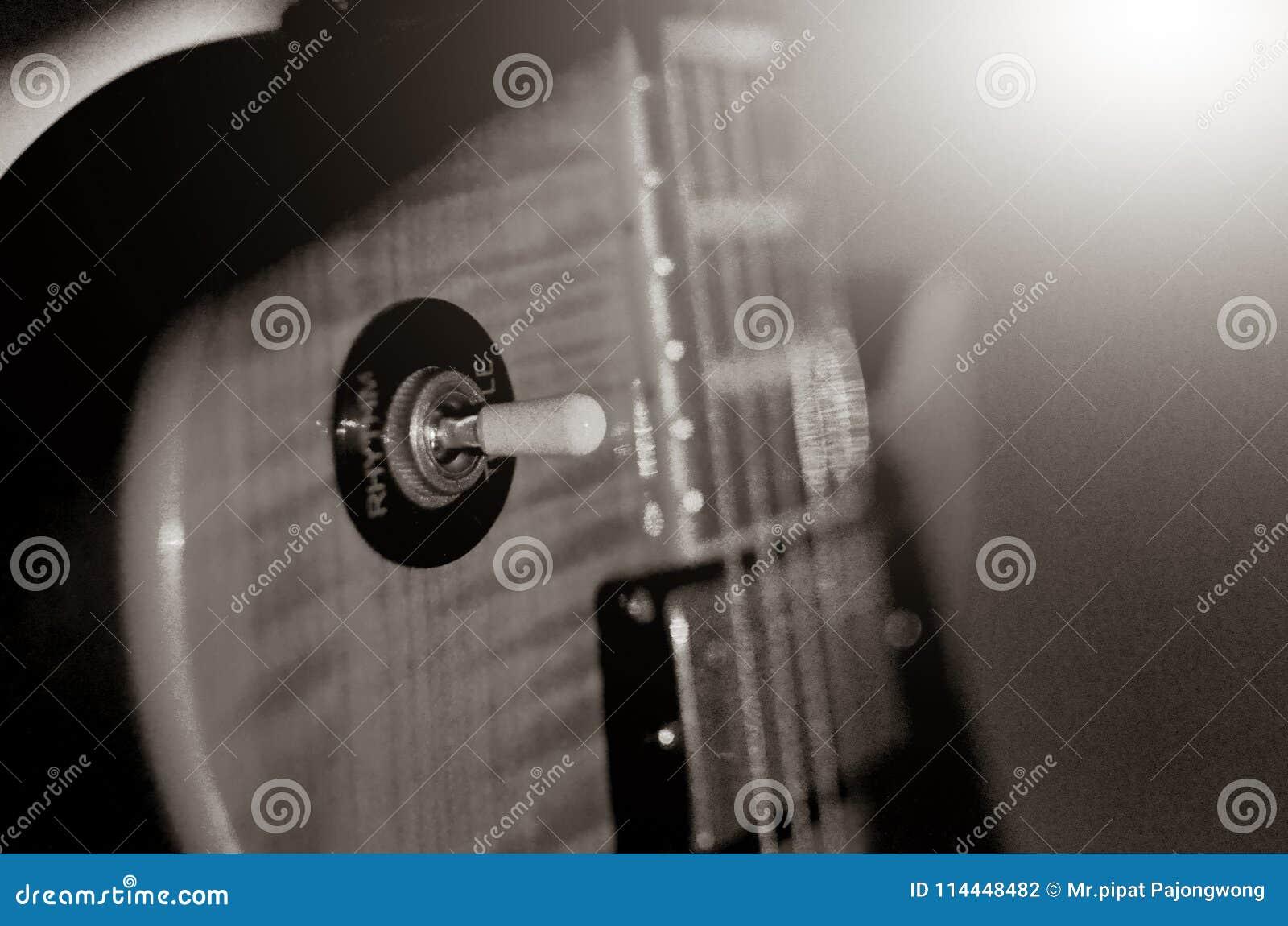 Foto abstracta de la guitarra eléctrica, blanco y negro macra