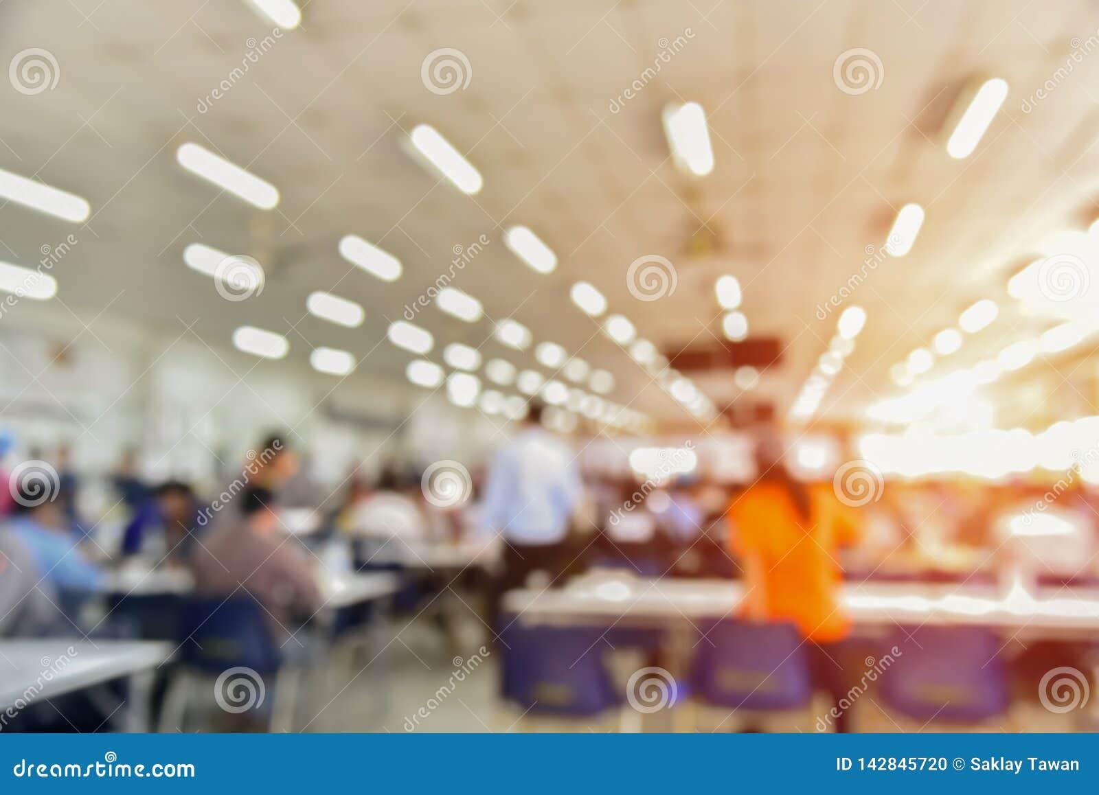 Foto borrada abstrata da sala de conferências ou da sala de seminário