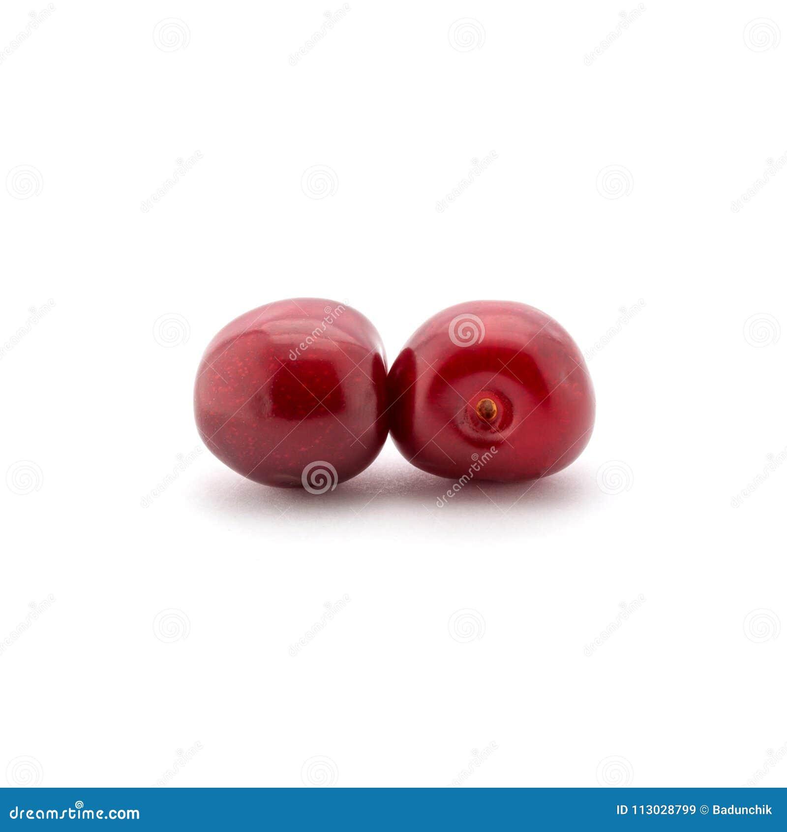 Foto de las cerezas rojas aisladas en el fondo blanco