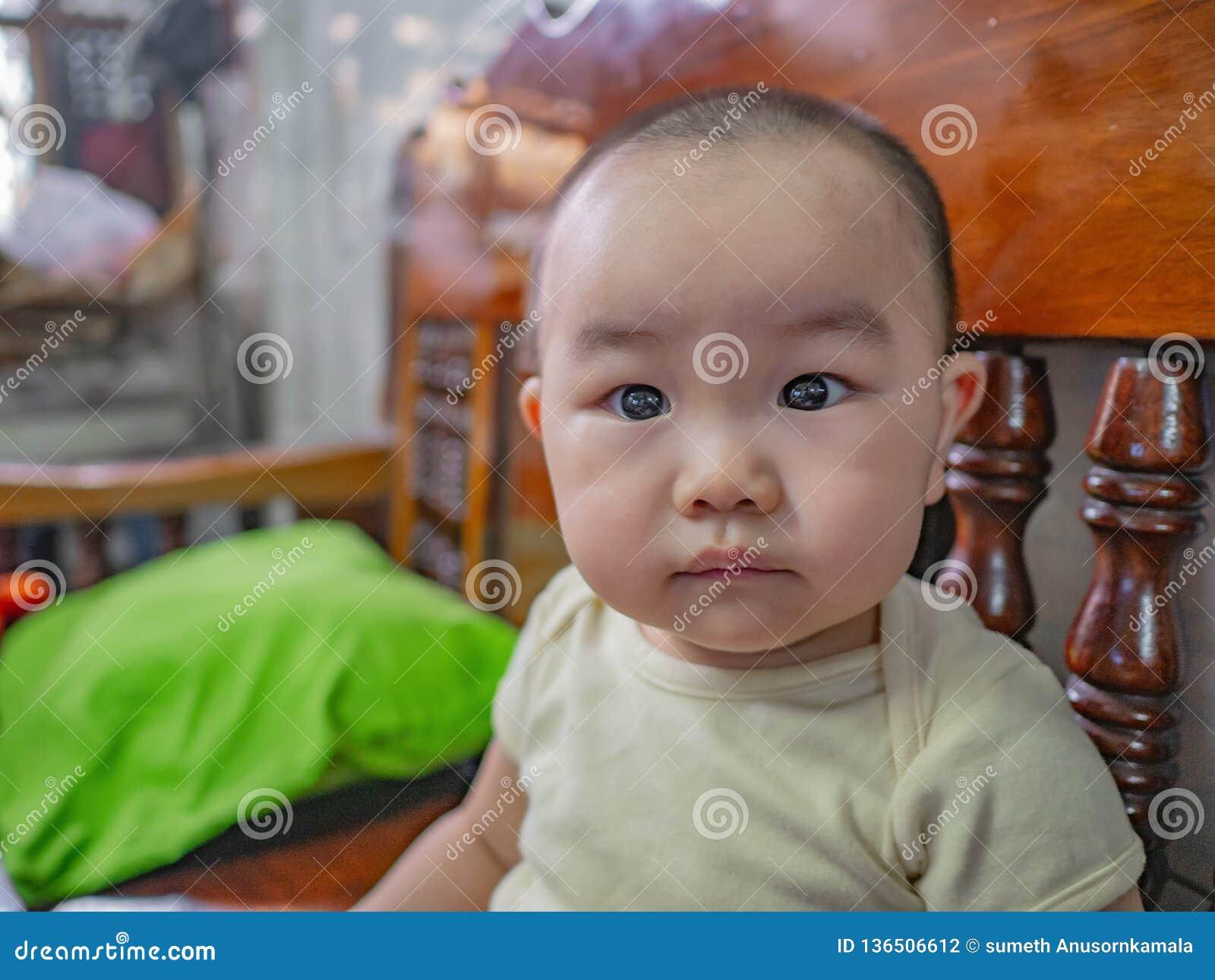 Foto del ritratto di Cutie e del ragazzo asiatico bello
