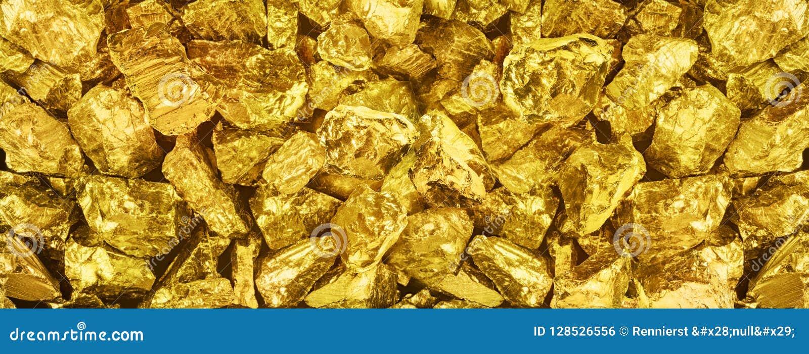 |Foto grande do panorama do close-up dourado de muitas pepitas Backgr largo