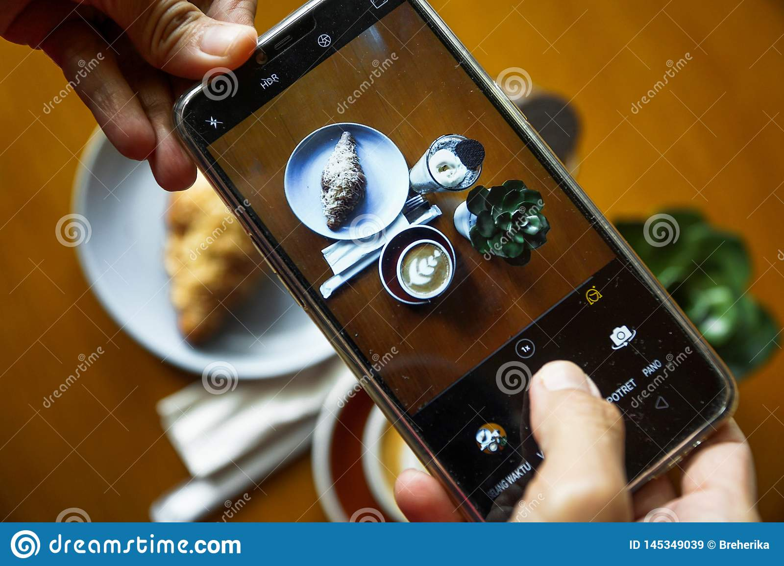 Food Photography Using Mobile Phone Product Photos Of Coffee Latte Croissant Chocolate And Blue Ocean Top View Photo Of Food Imagen De Archivo Imagen De Chocolate Photo 145349039