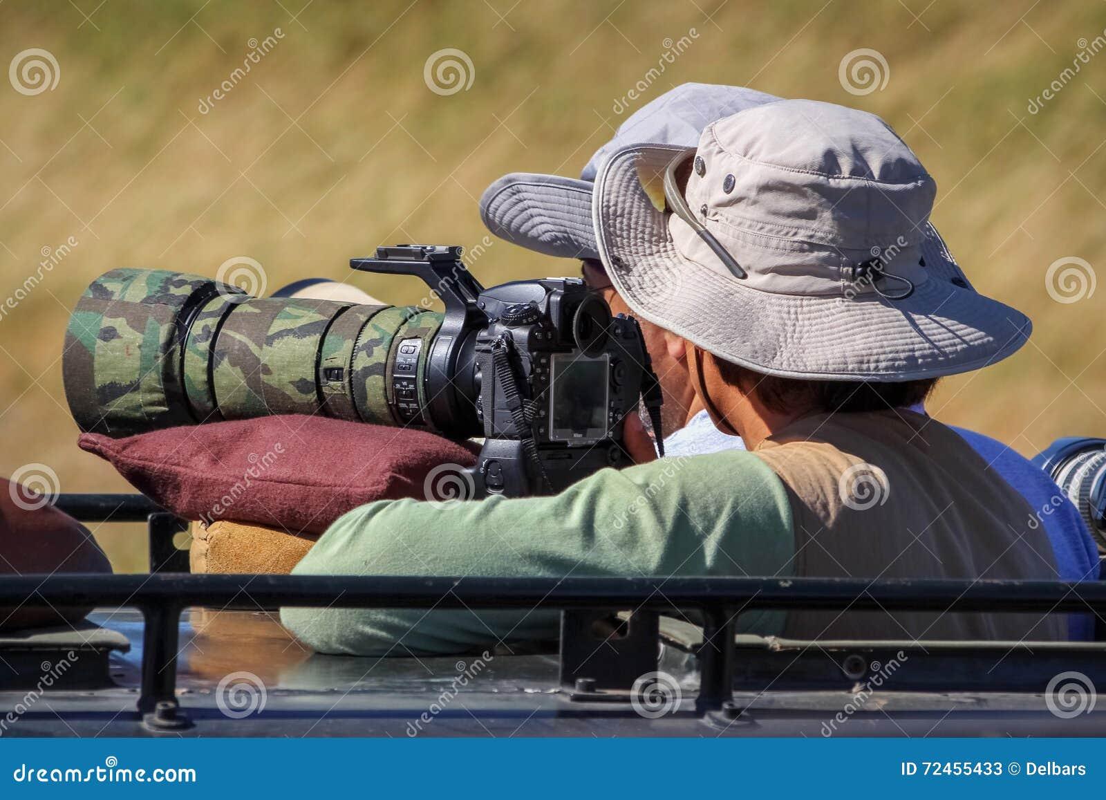 Fotograf bierze obrazki dzikie zwierzęta w Afryka