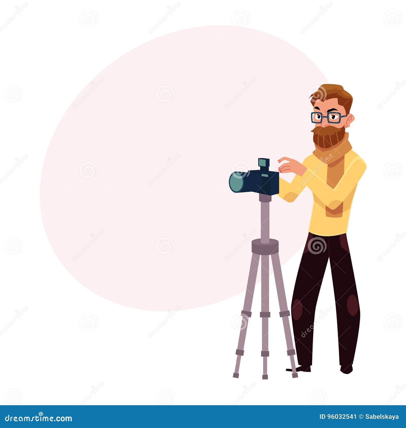 Fotograf bierze obrazki, strzela w studiu, cyfrowej kamerze i tripod,