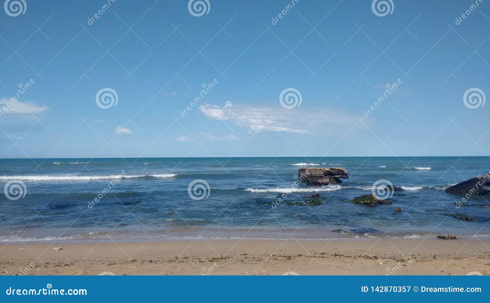 Fotografi av stranden av Miramar arenaceous