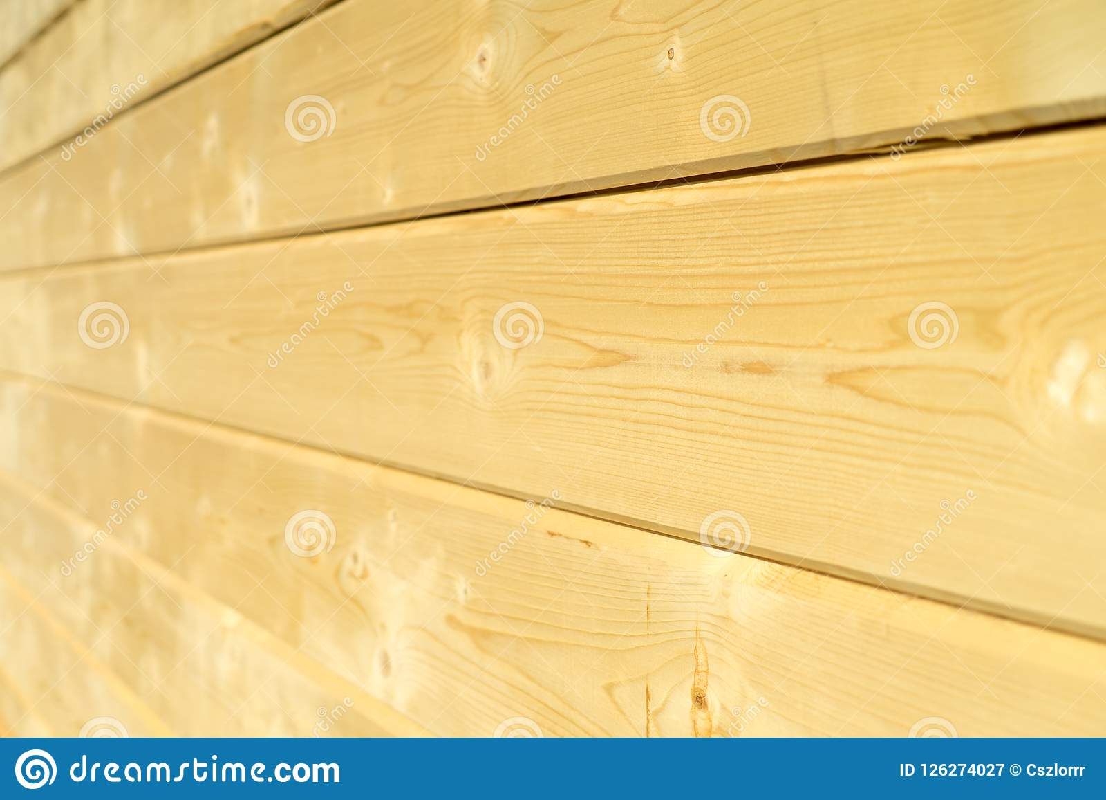 Fotowand eines Holzhauses gemacht von den Holzbalken