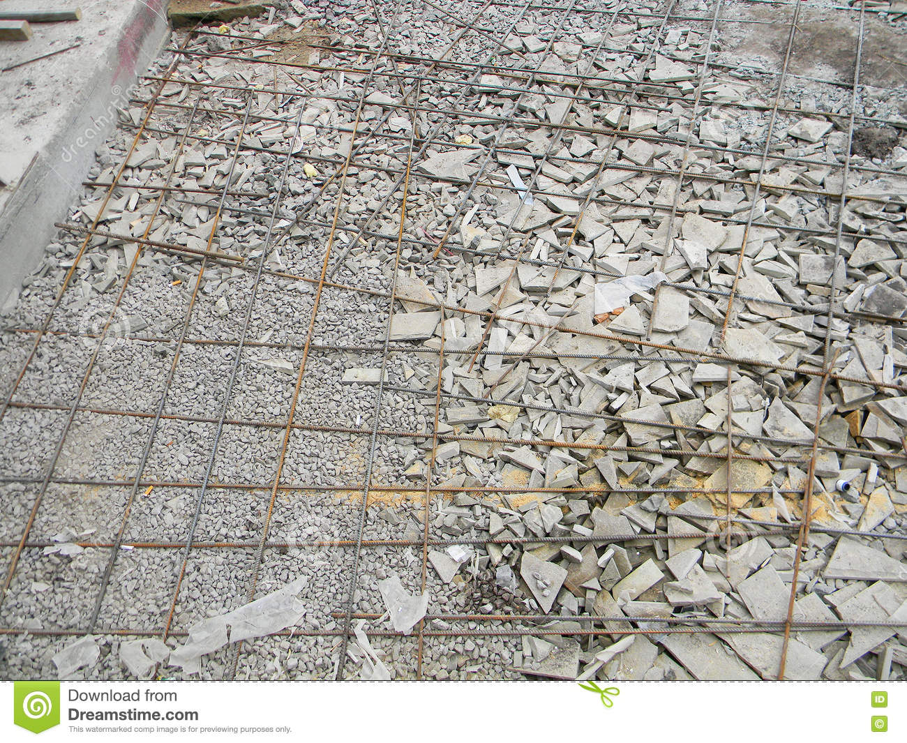 Foundation With Iron Bars Frame For Paving. Building New Concrete Pavement  For Patio. Stock