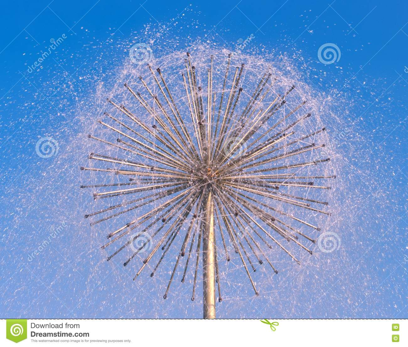 Fountain As Dandelion With A Blue Sky Stock Photo