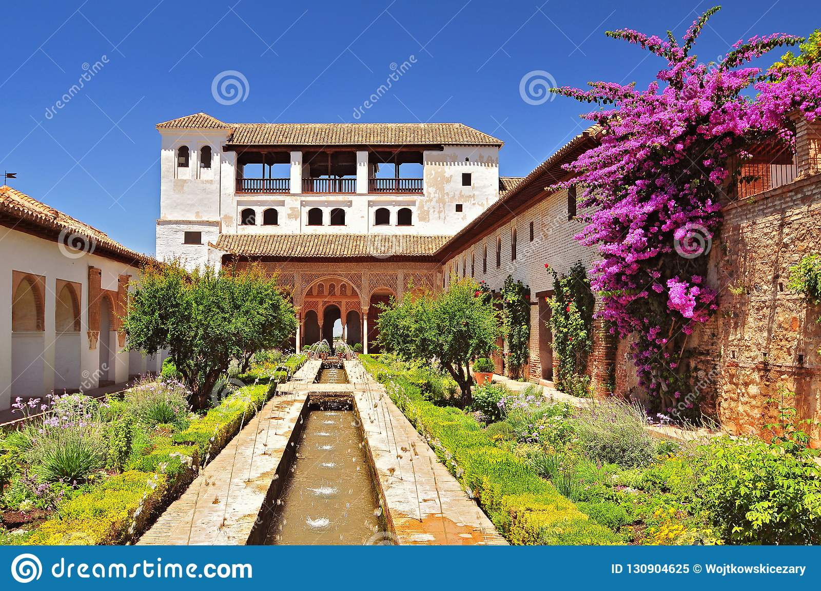 Fountain and gardens in Alhambra palace, Granada, Andalusia, Spain.