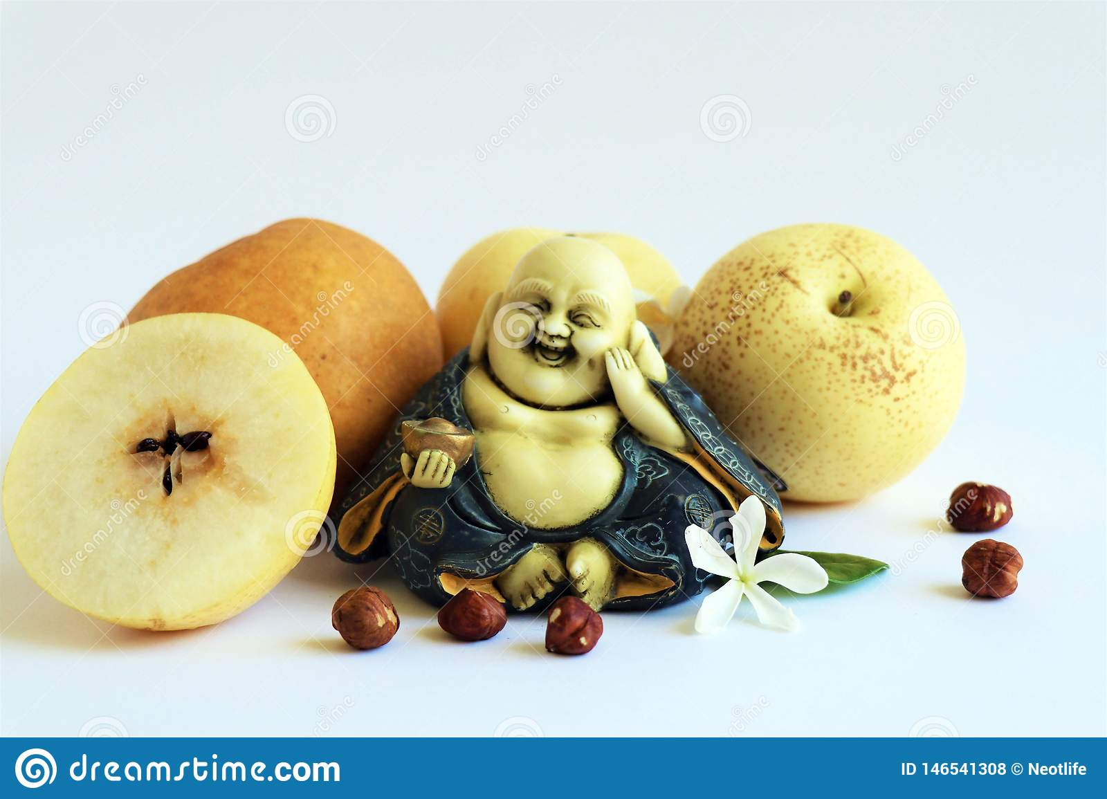 Four asians pears with smiling Buddha
