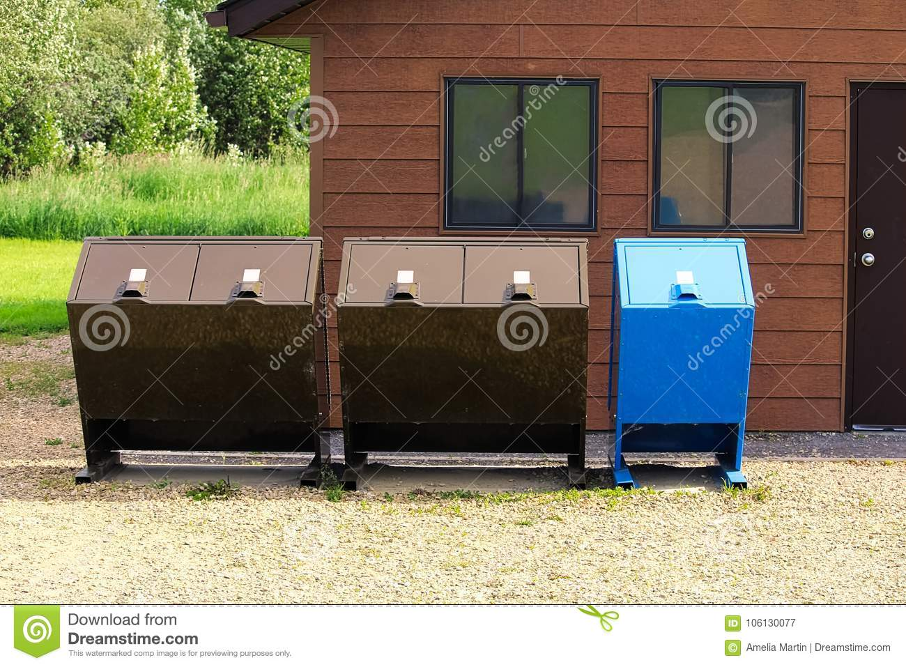 Four Bear Proof Garbage Cans With A Recycle Bin Stock Image