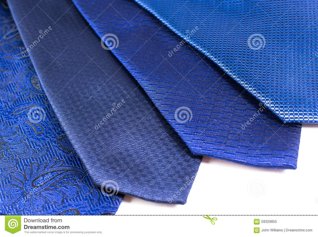 0286faec011971 Four blue silk ties in a display row belonging to a modern business man on  a white background