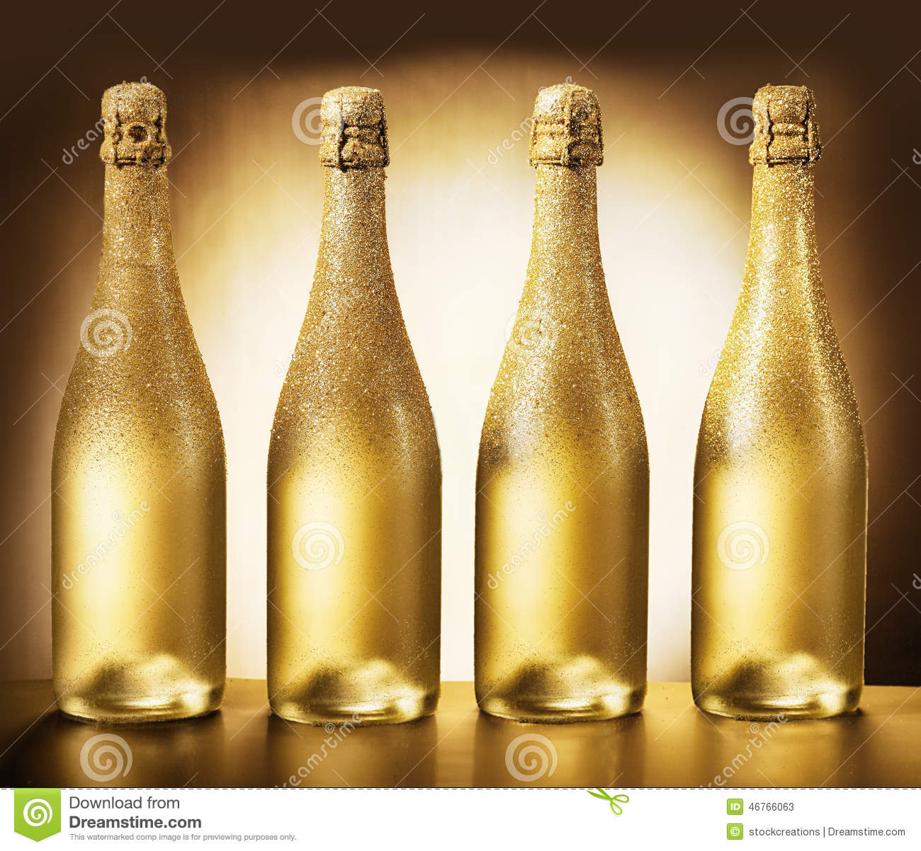 Four Bottles Of Golden Champagne Stock Image