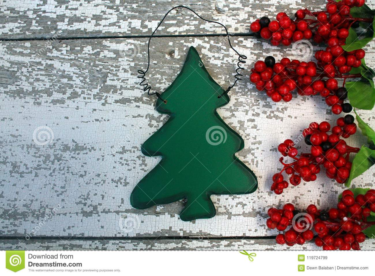 christmas tree decoration on white background with red berries