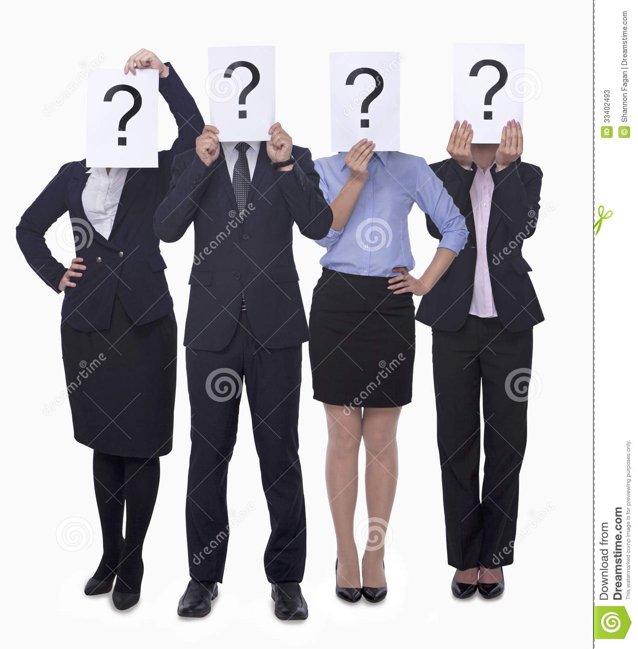 Four business people holding up paper with question mark, obscured face, studio shot