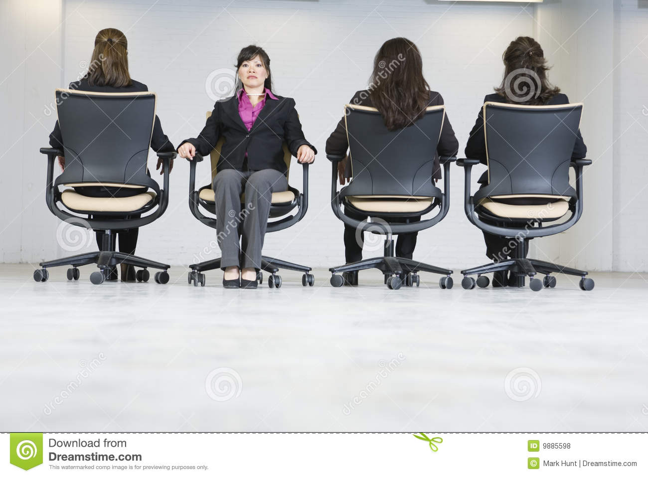 Rear View Of Four Business Women Sitting On Office Royalty