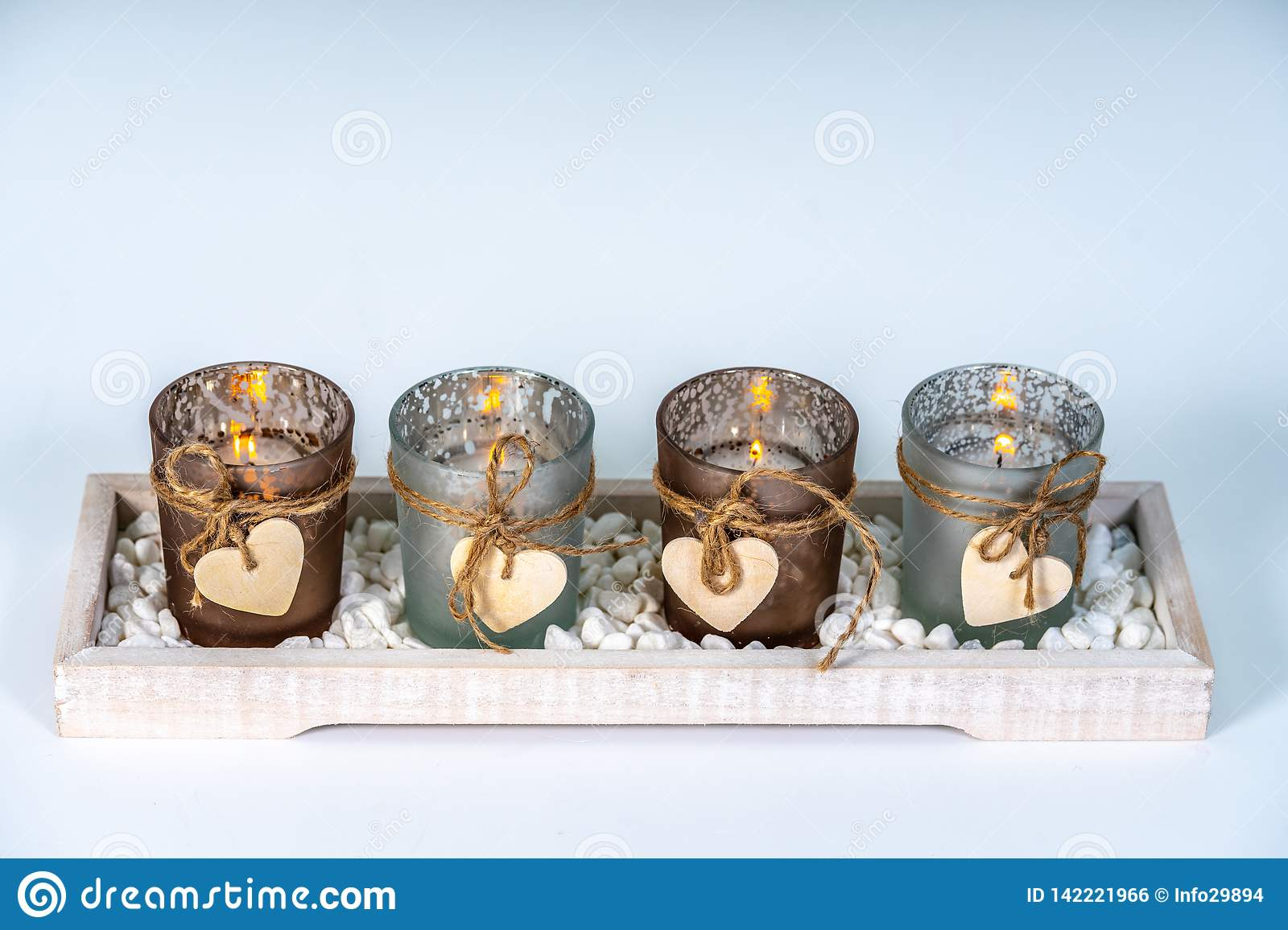 4 candlesticks decorated with a heart