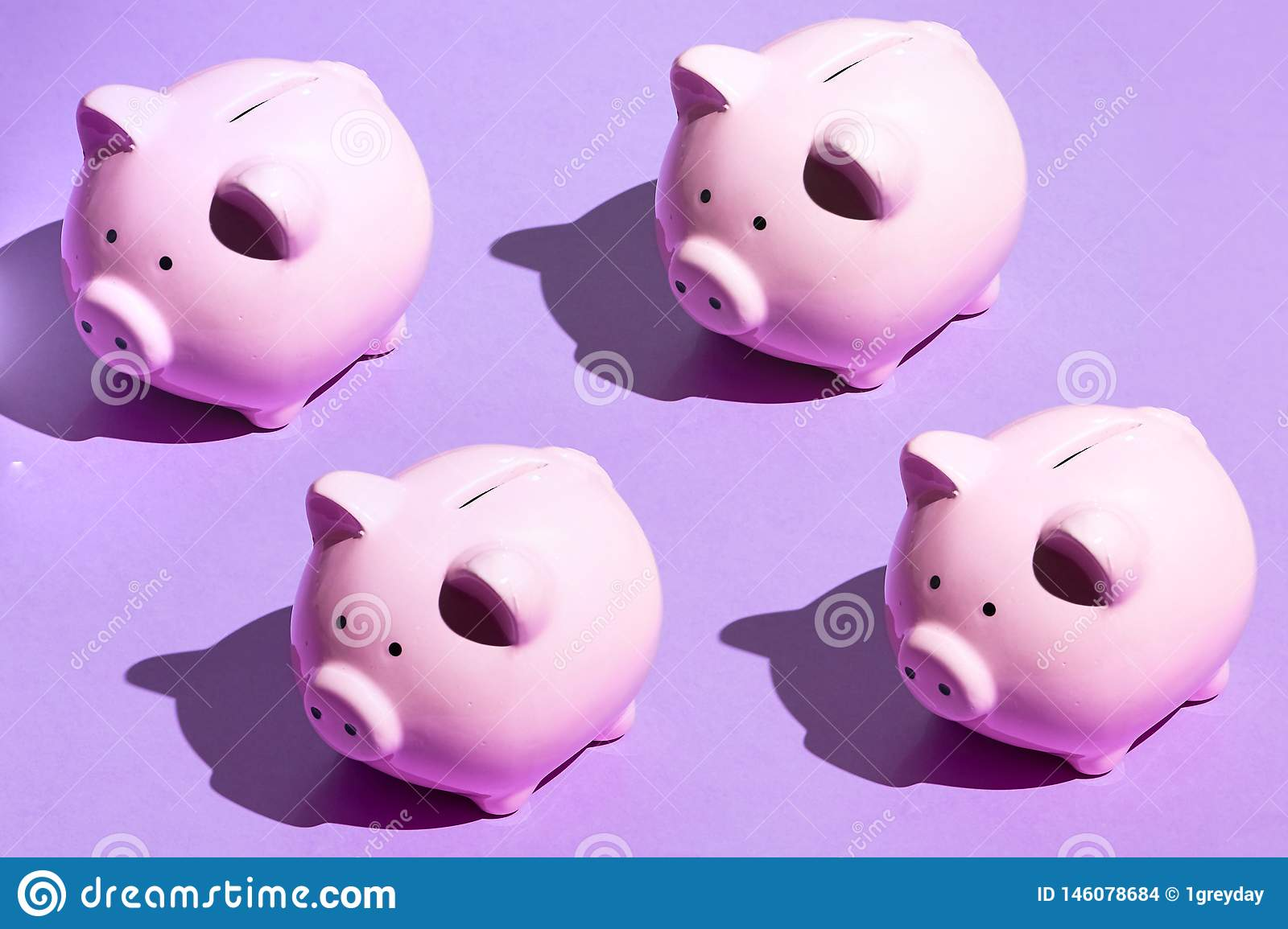 Four ceramic moneyboxes on the blue background