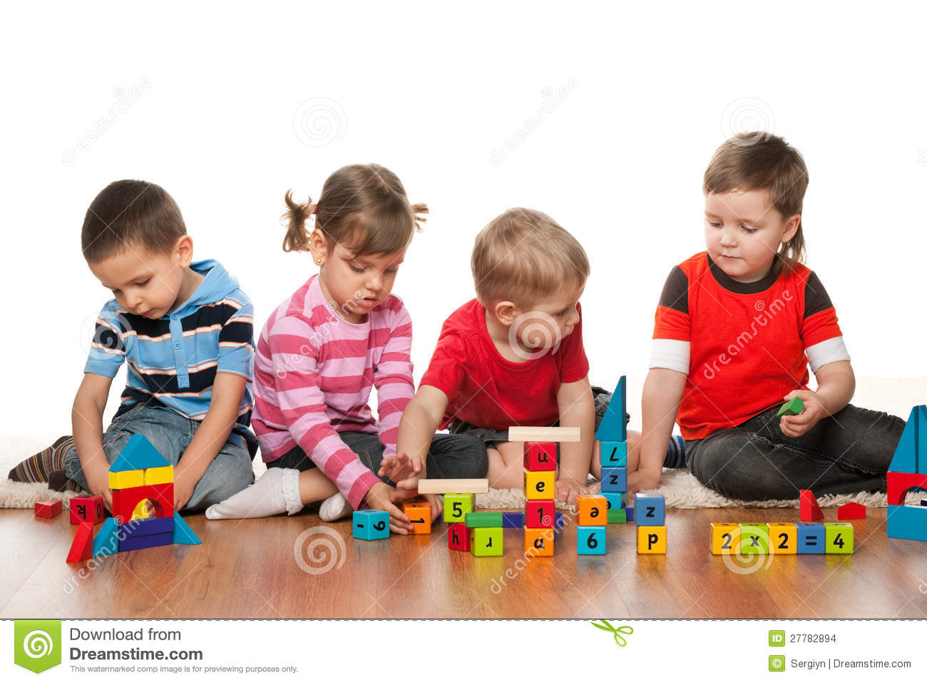 Four Children Are Playing On The Floor Stock Images