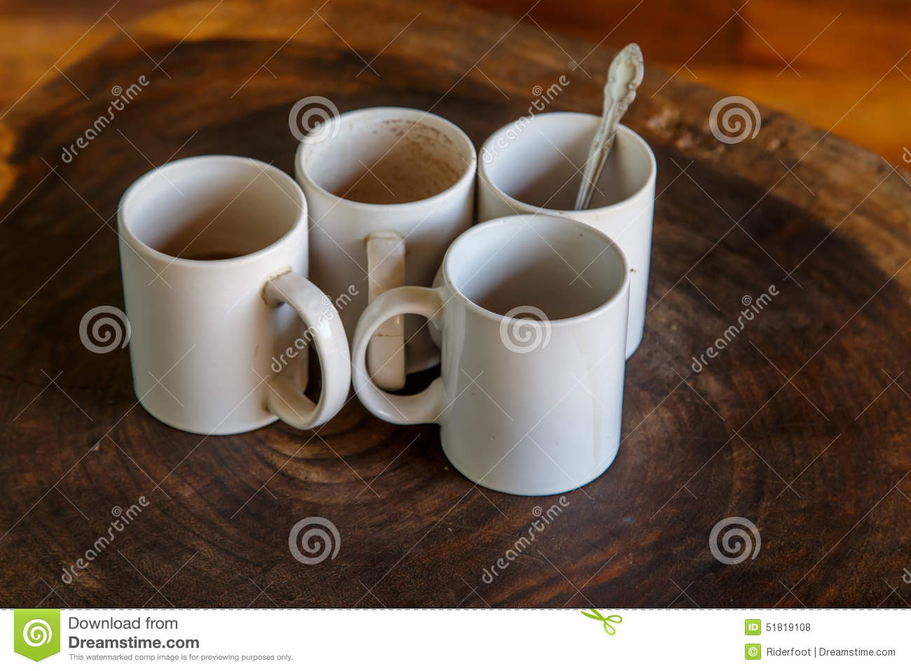 Four coffee cups in a table stock photo image 51819108 four coffee cups in a table geotapseo Gallery